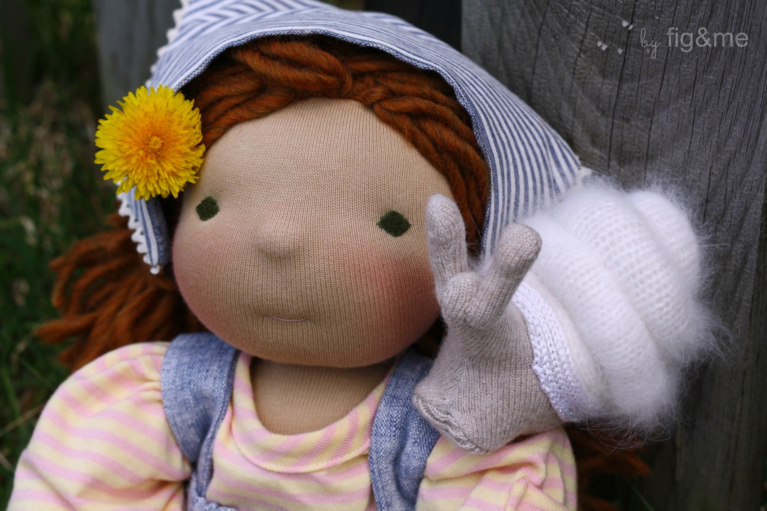handmade doll and snail toy