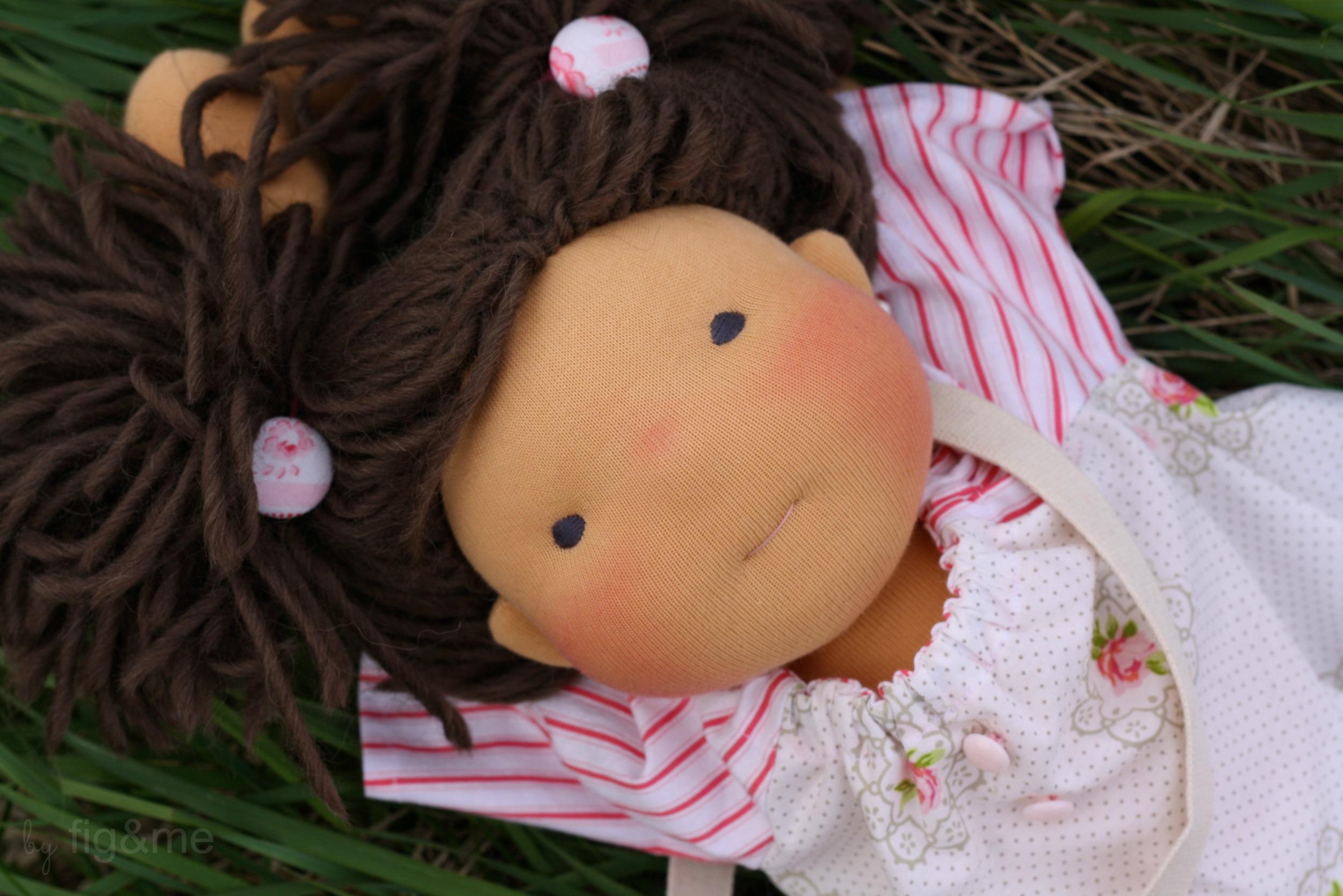 A doll wearing handmade hair elastics, by Figandme.