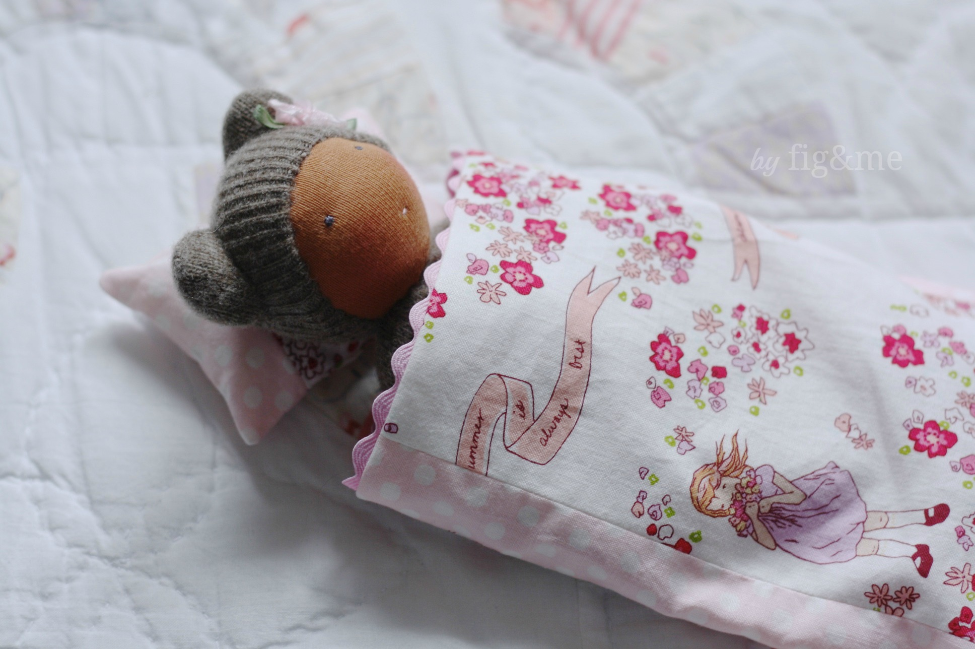 a wee bear sleeping in a bed of pinks