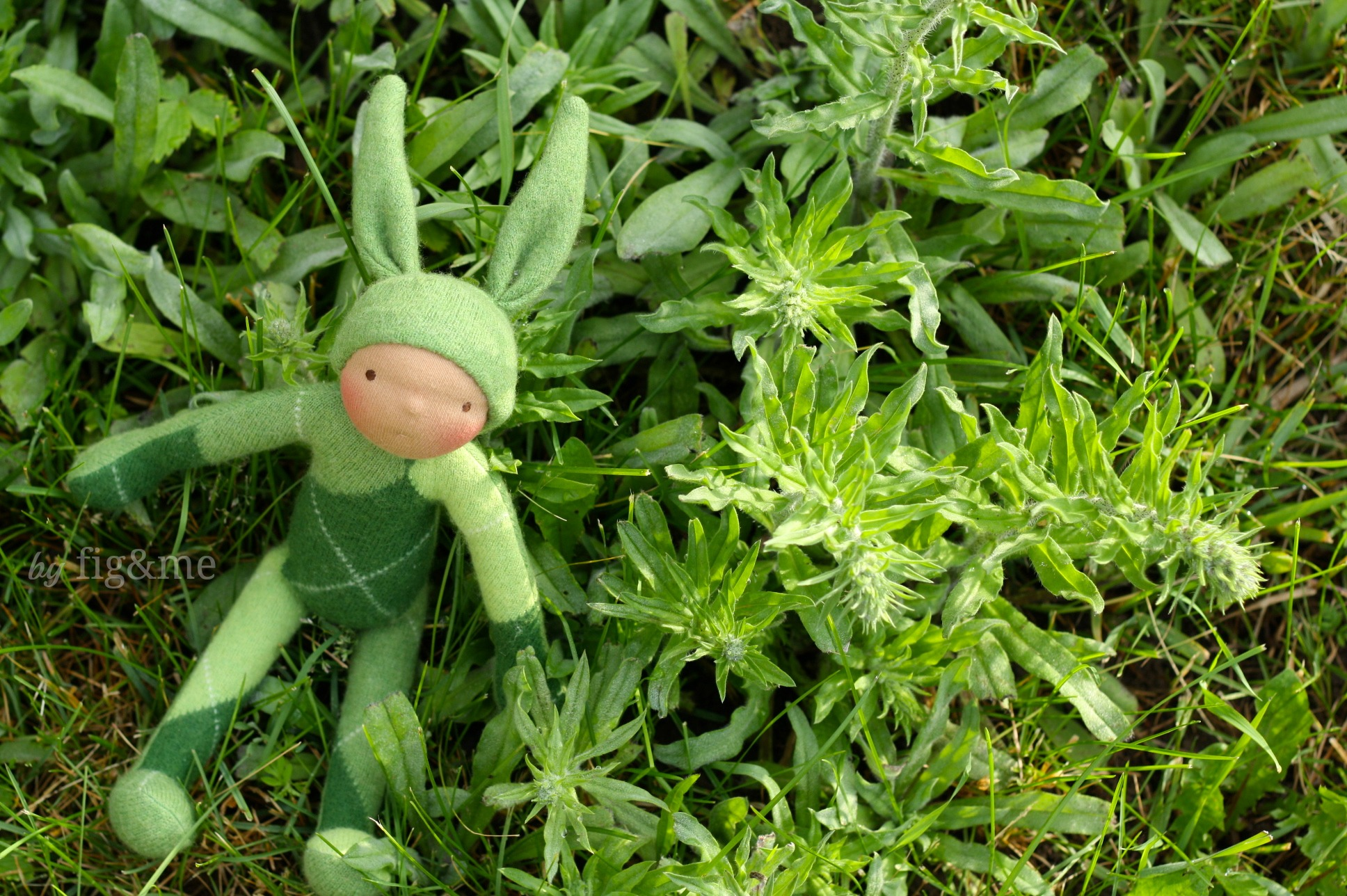 A handmade bunny doll in camouflage, by Fig and Me.