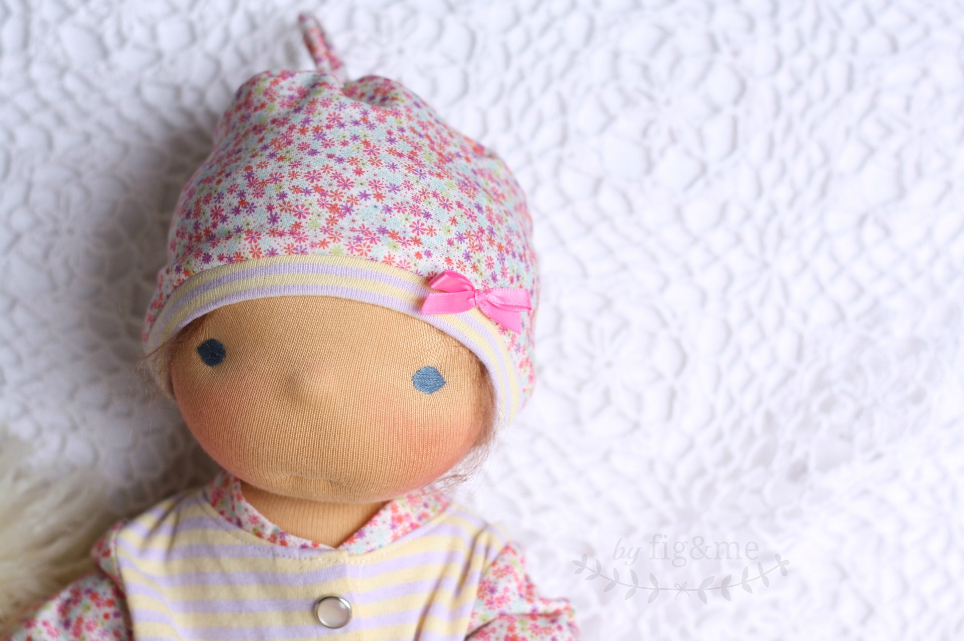 Baby doll in knotty hat, fig and me.