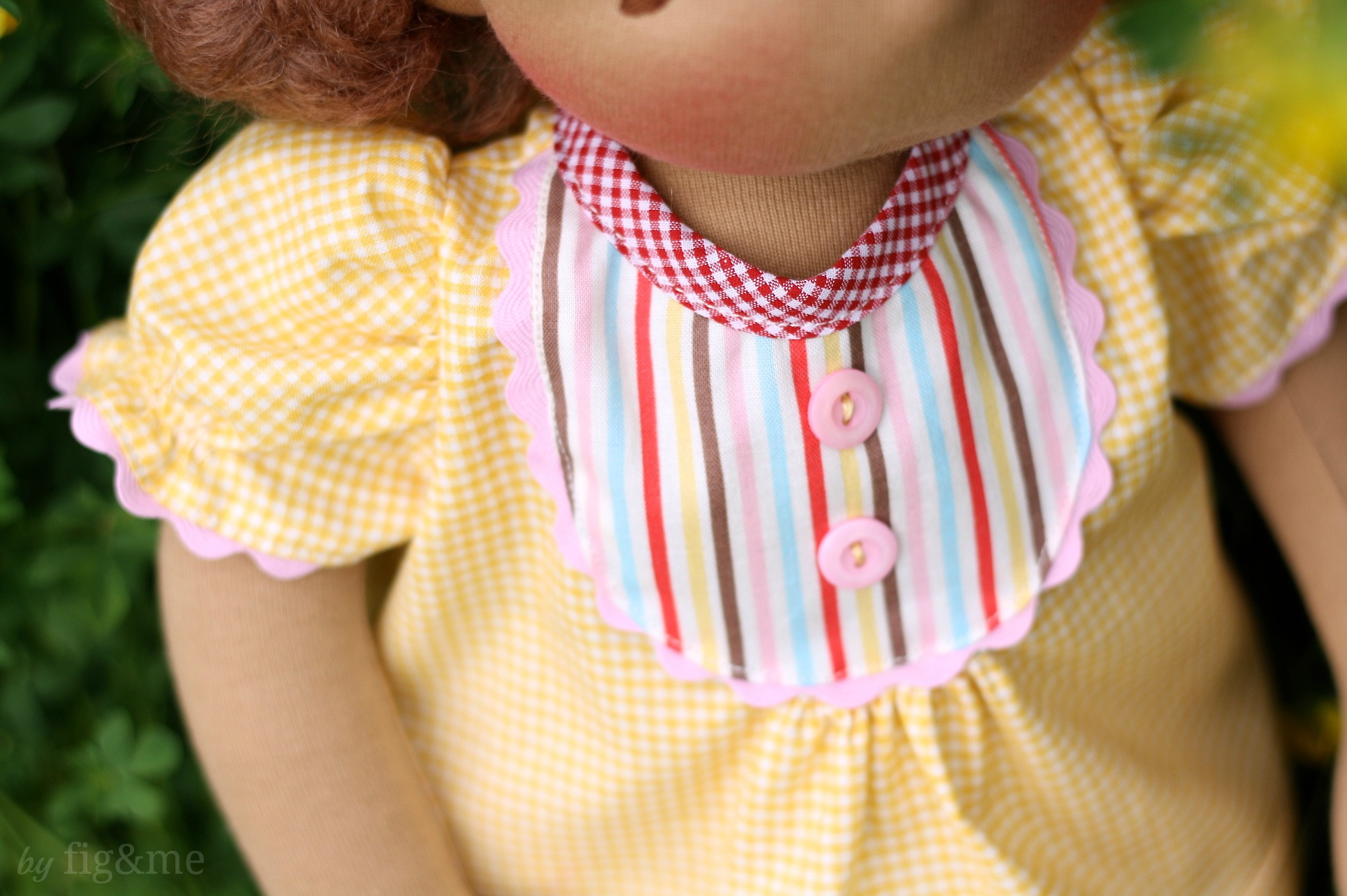 Doll blouse with front bib edged in ric rac, by fig and me.