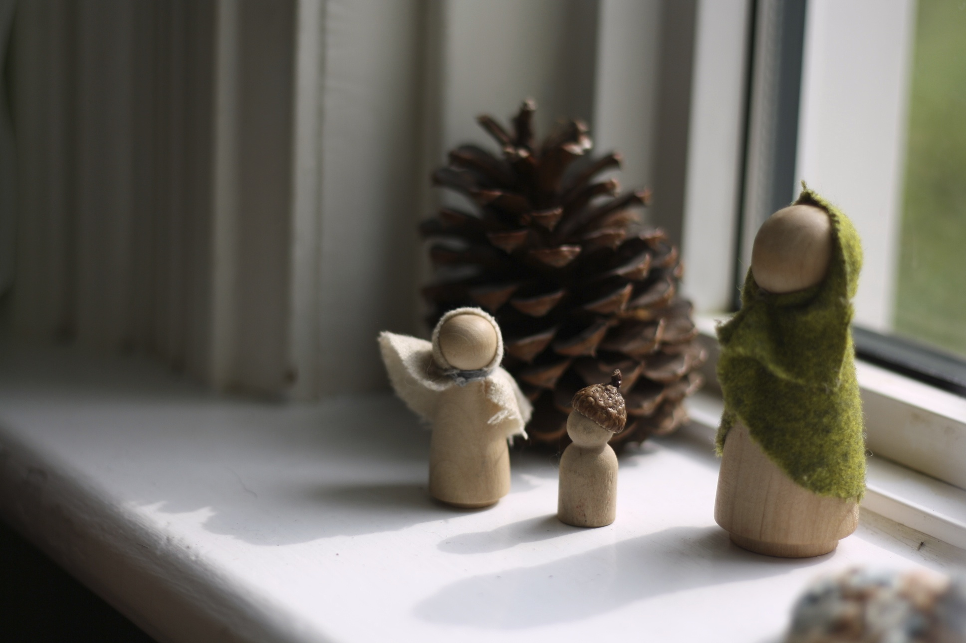 Wooden peg dolls on our window sill, by Fig and me.