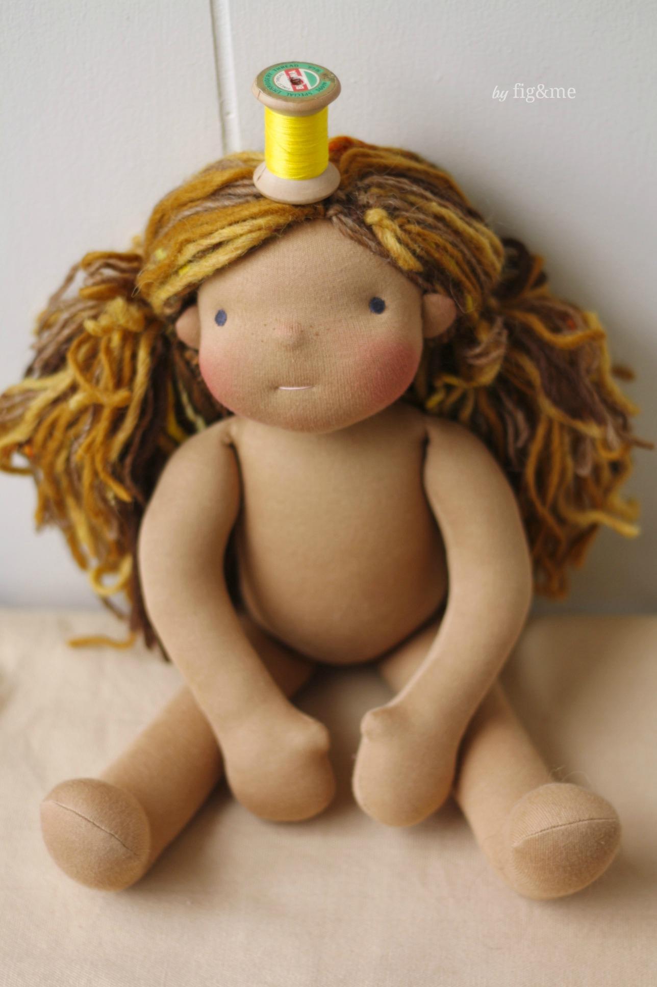 Lottie wearing a yellow spool of thread, by Fig&me