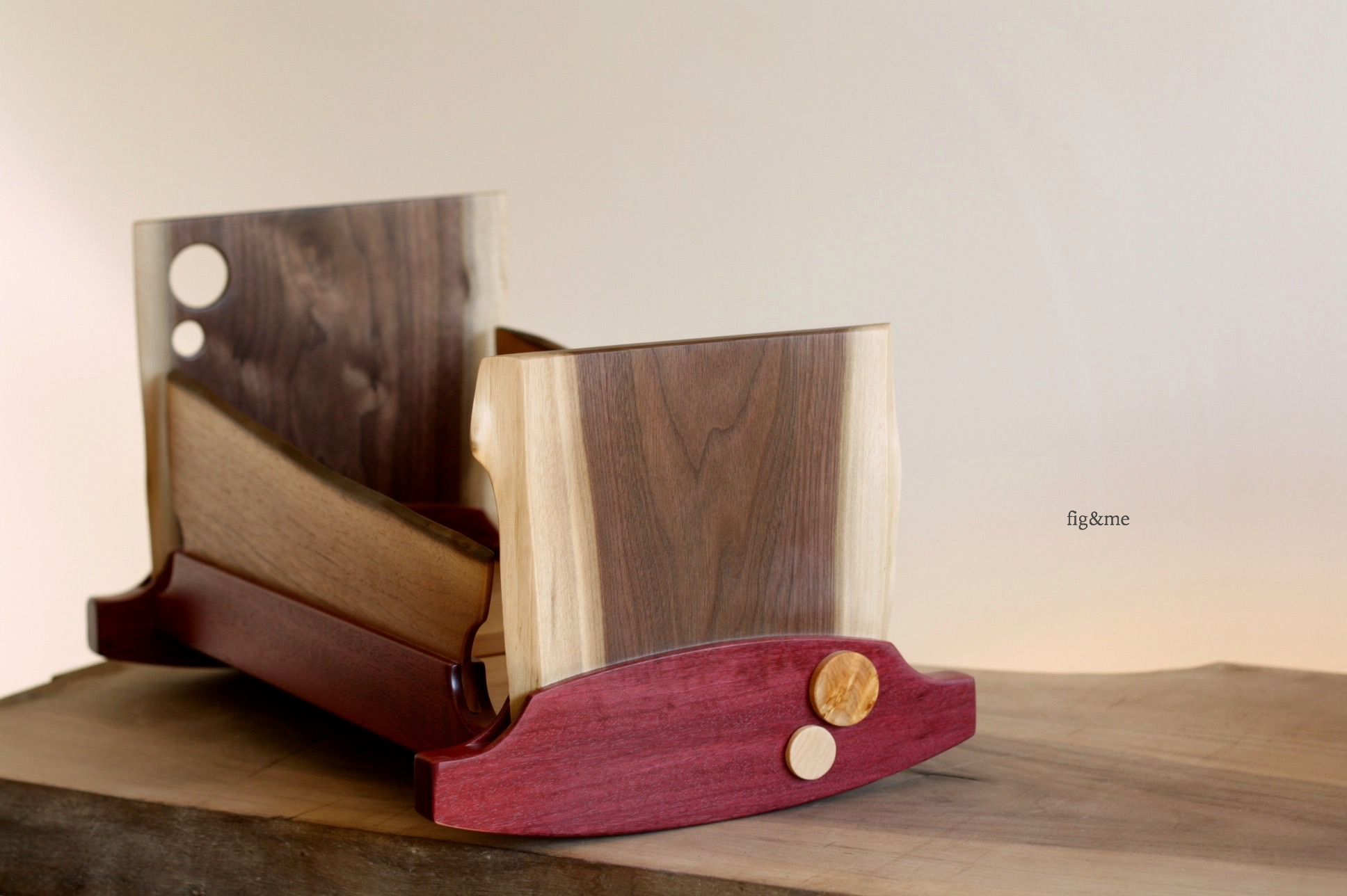 Wooden doll cradle, made with purple heart and live-edge walnut by Fig and me.