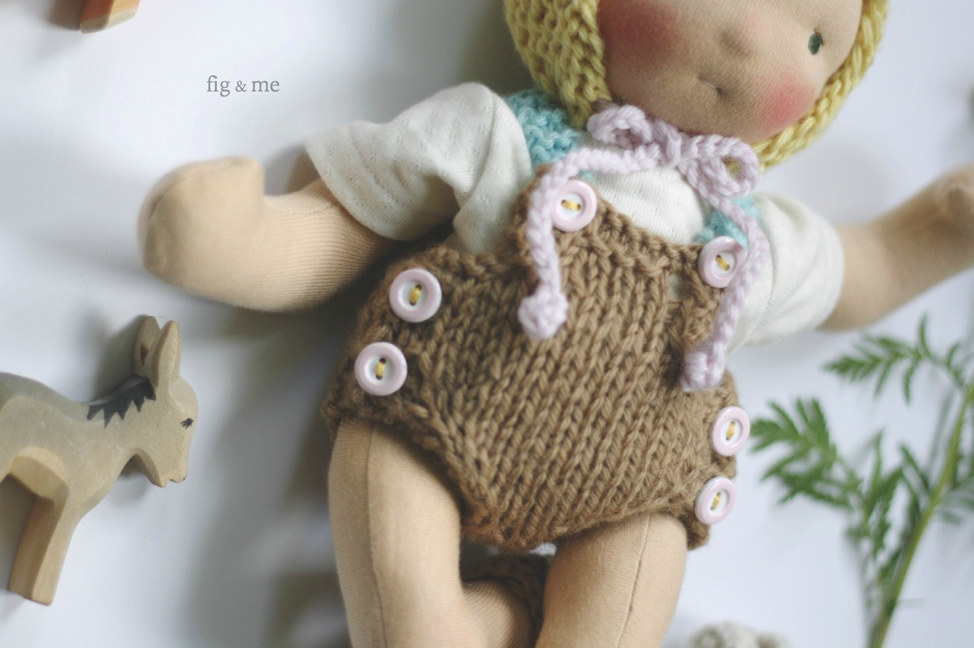 Hand-knitted baby short-alls for a cloth doll, by fig and me.