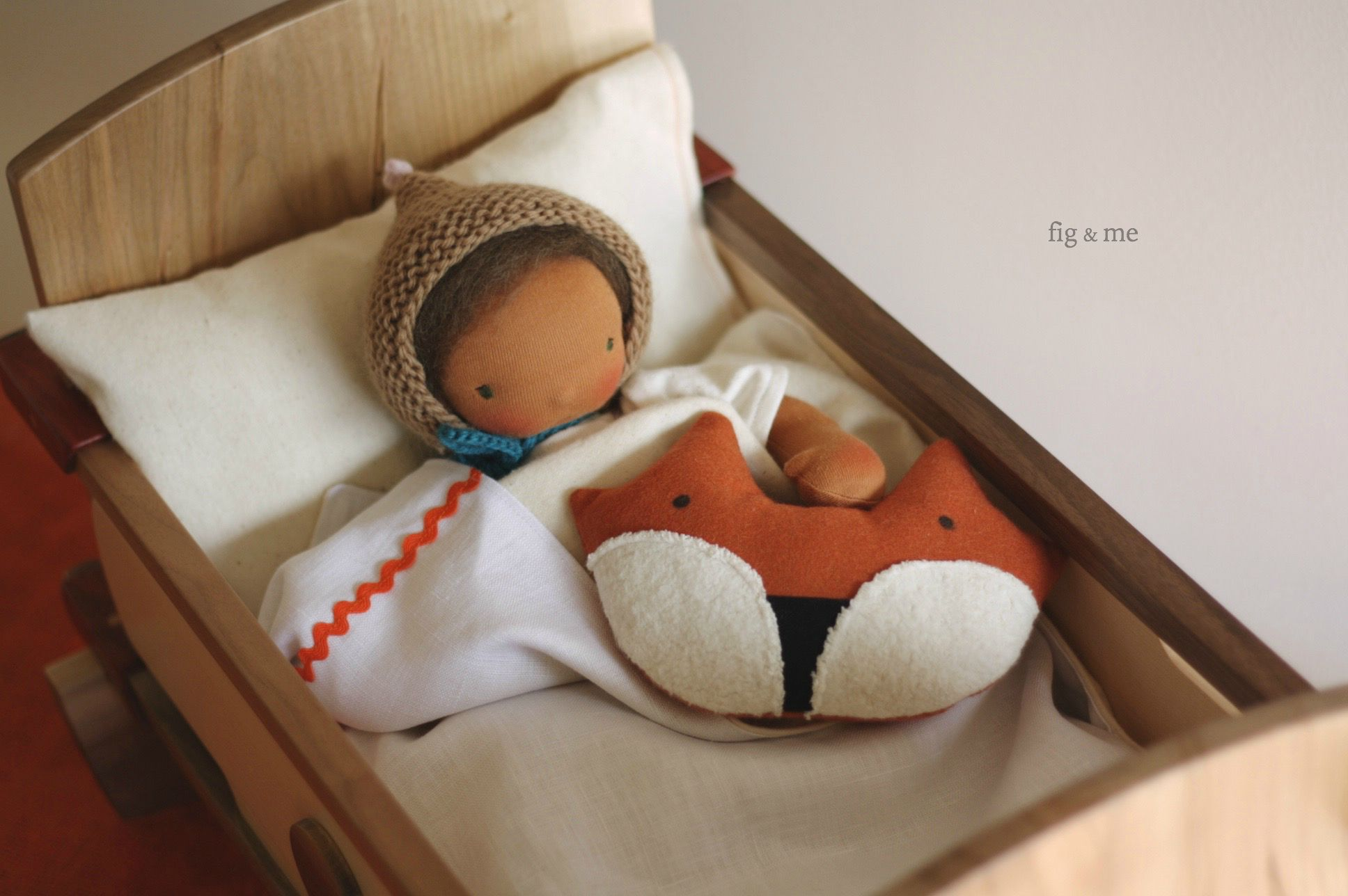 Baby Calpurnia in her wooden cradle, by Fig and me