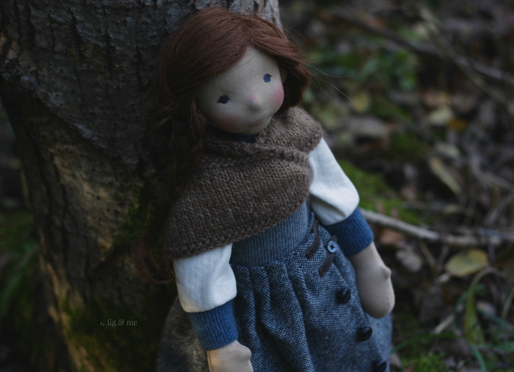 Skye, sitting in the forest, a natural fiber art doll by Fig and me.