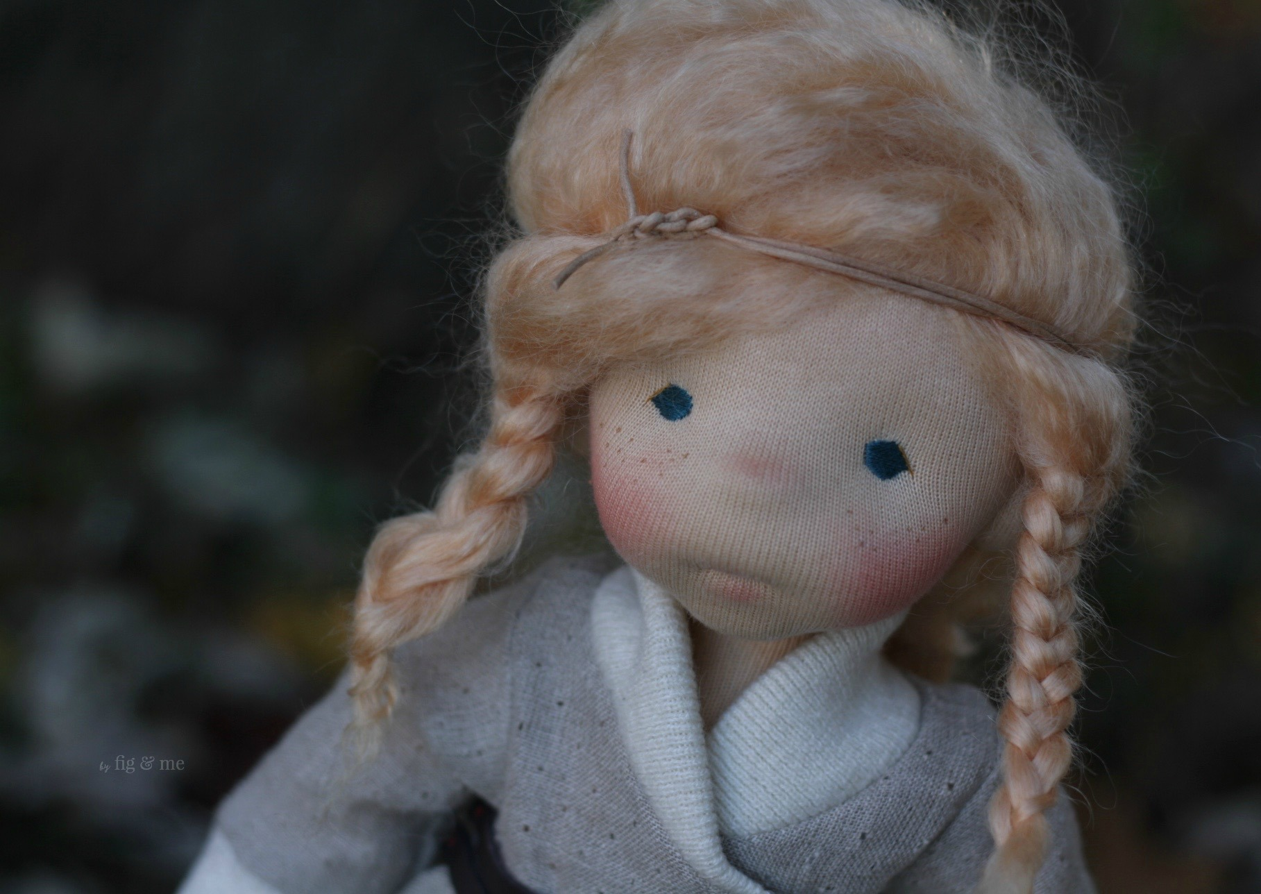 Iona with her lovely freckles and impish eyes, a natural fiber art doll by Fig and me.