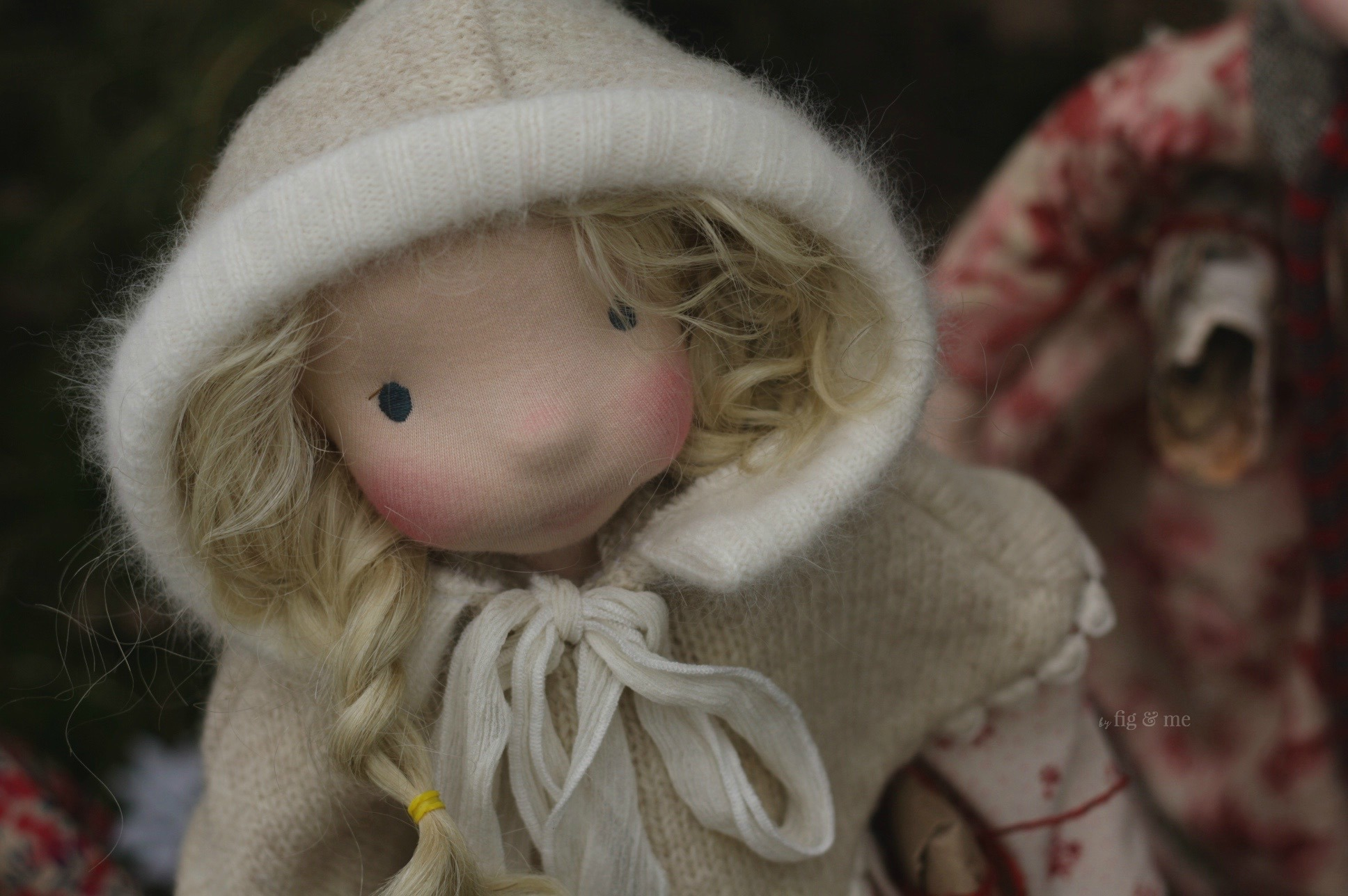 Freyja wearing her lambswool hooded cape with angora collar and long fabric ties, by Fig and Me.