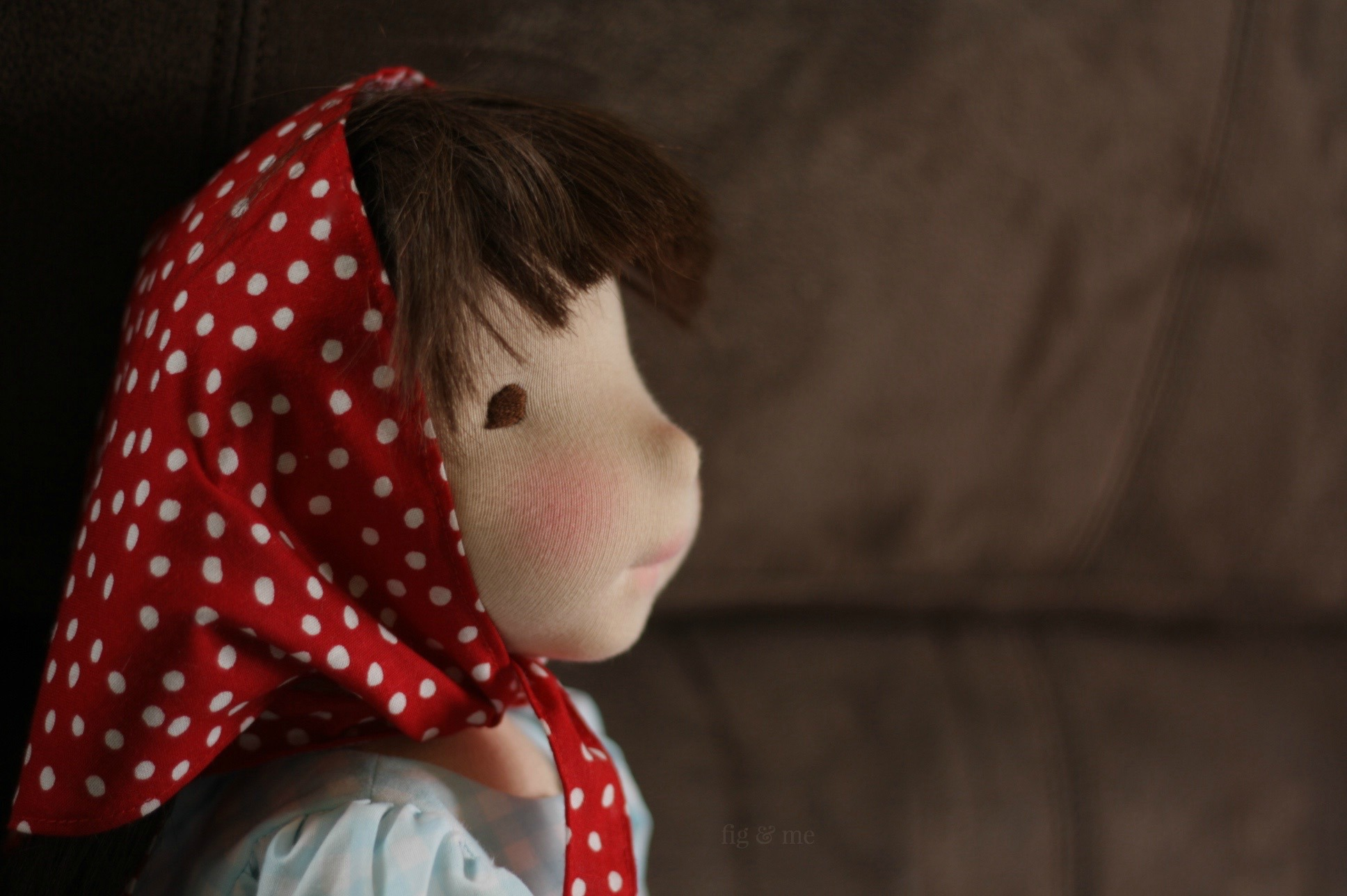 Thinking of who the next victim will be. Imogen, the outlaw. A natural fiber art doll by Fig and Me.