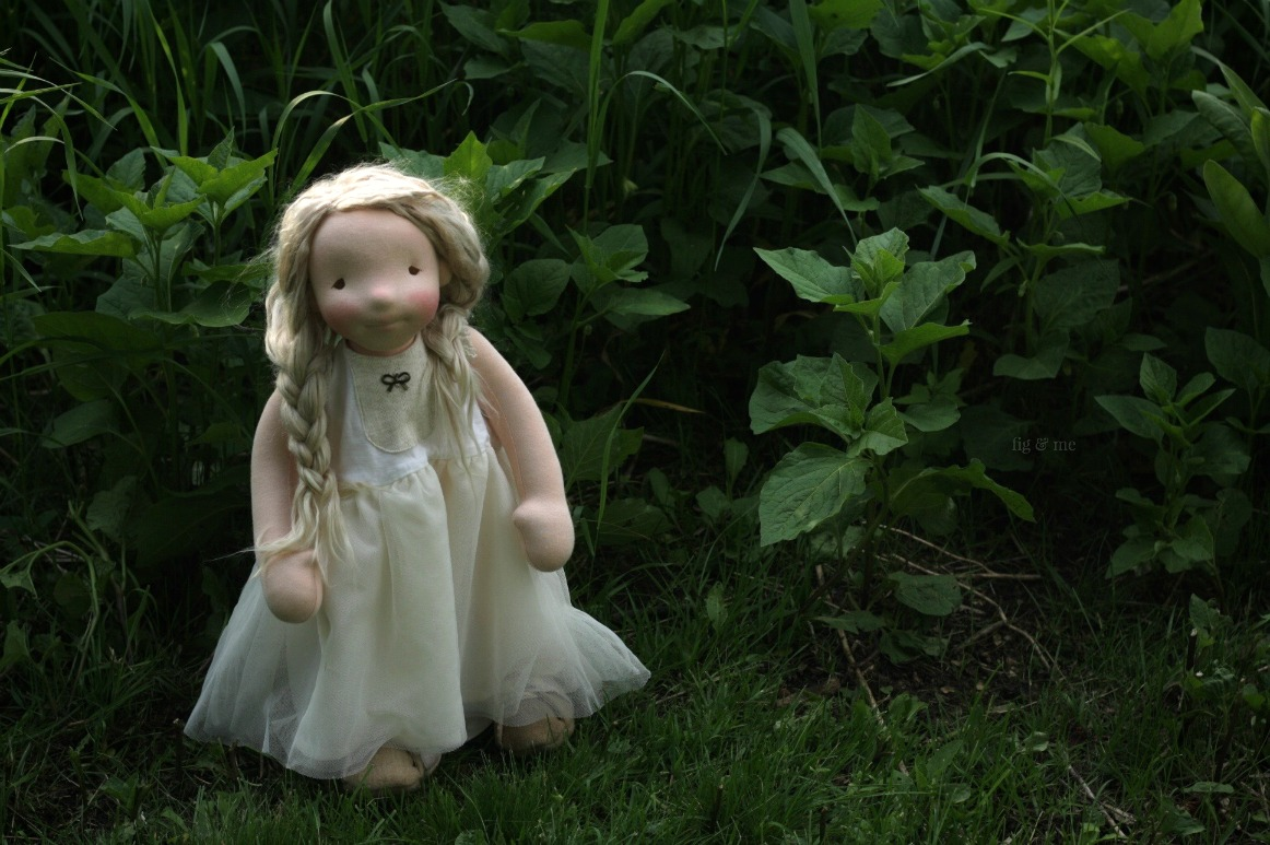 Phoebe in the garden. Phoebe is a one of a kind natural fiber art doll, by Fig and Me.
