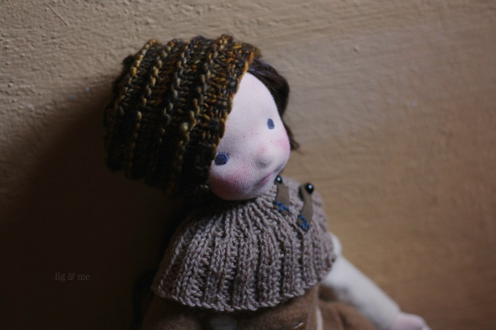 Hepsibah, wearing her Sassenach knits: a slouchy toque knit with Malabrigo and a ribbed capelet with leather ties. By Fig and Me.