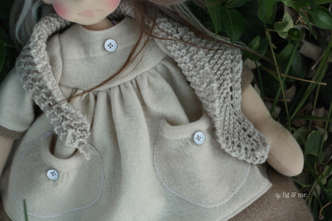 Bronwen wears a slightly felted merino dress, with mom pockets and shabby chich buttons. By Fig and Me.