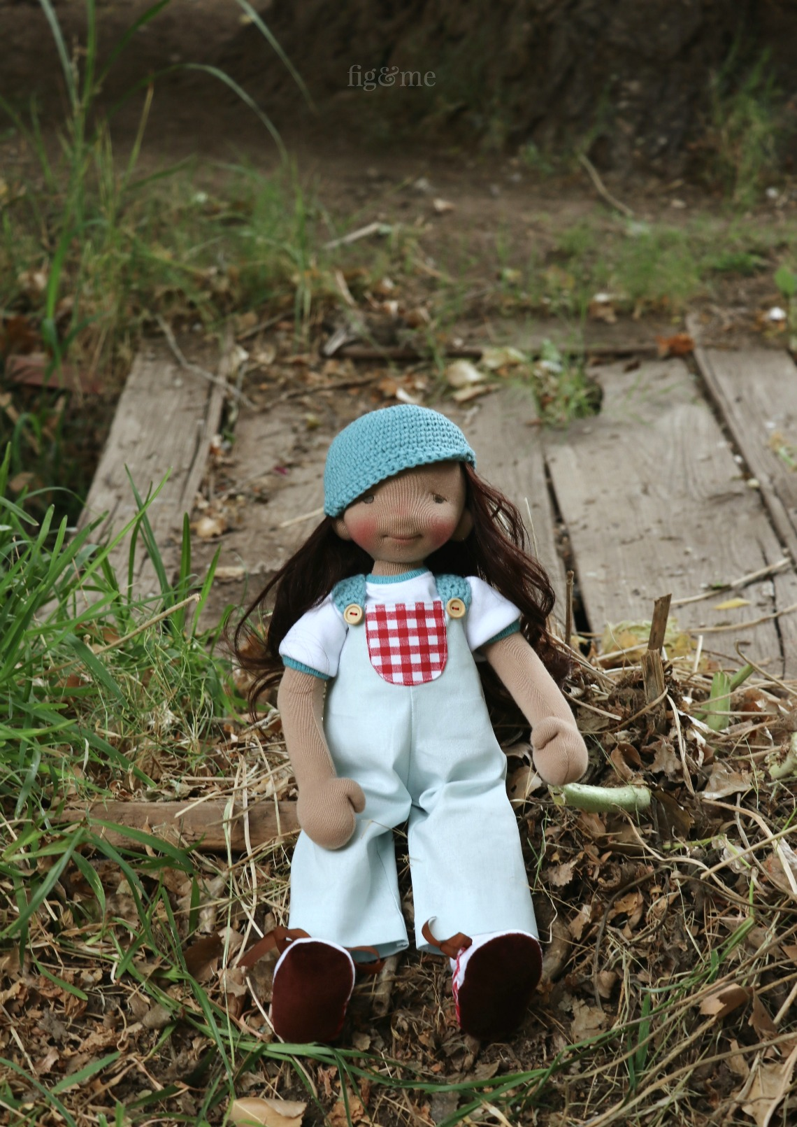 Eileen is a natural fiber art doll, made with cotton and wool, and wearing her handmade clothes.