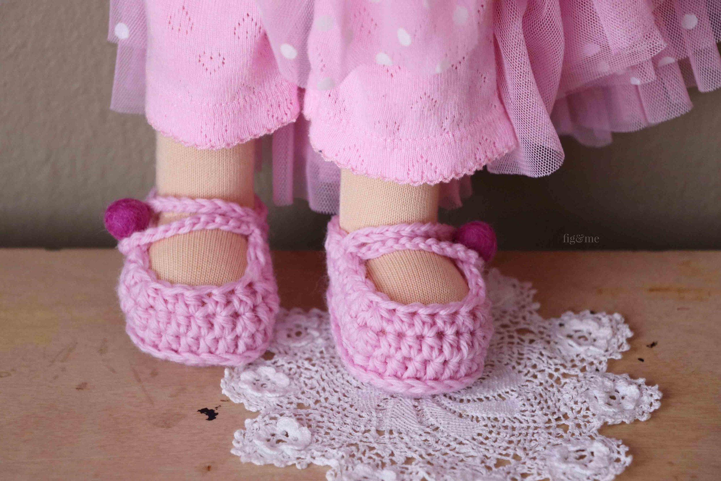 Aoki and her pretty wool crochet shoes with wool felt beads as buttons. By Fig and Me.