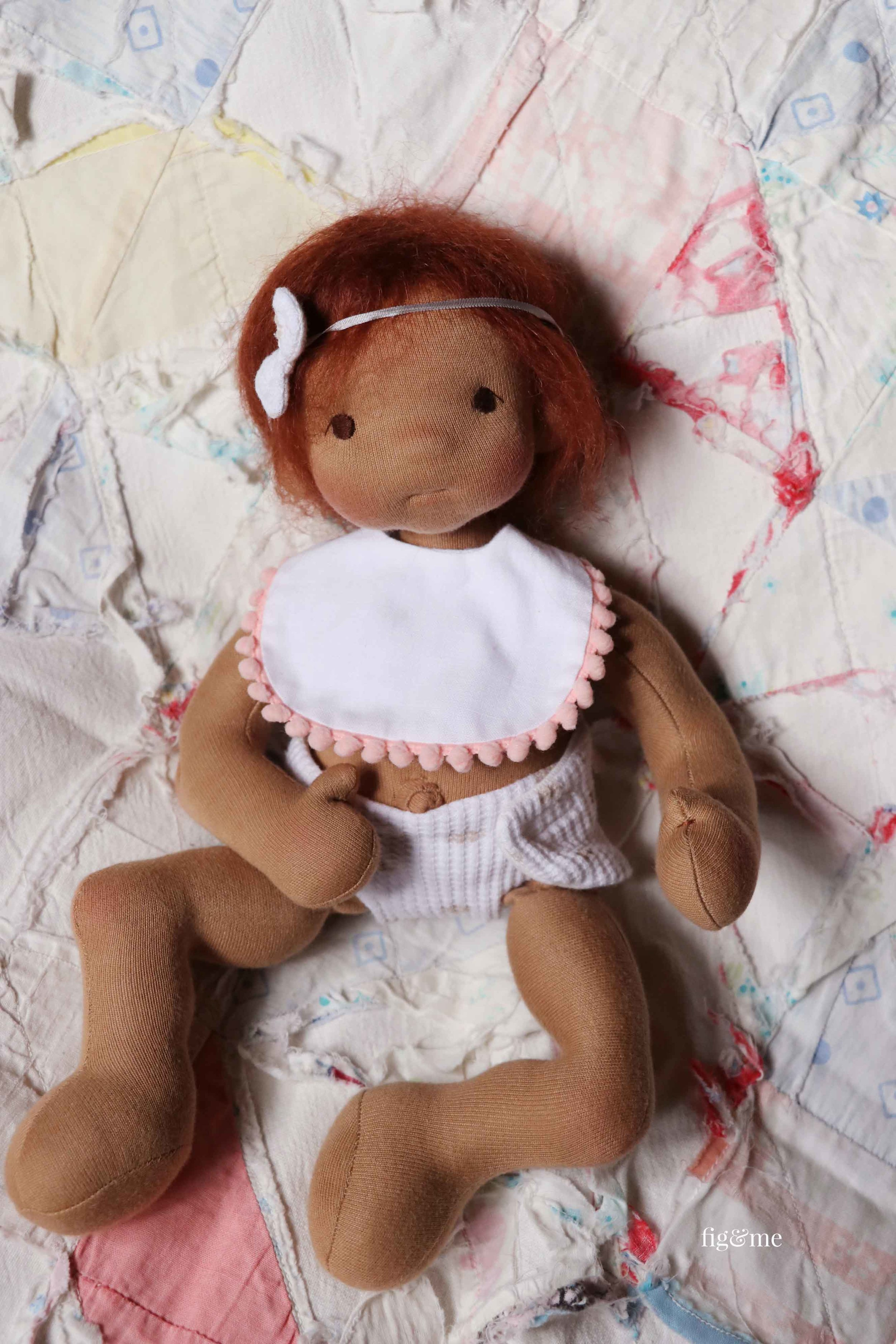 Take the Baby Fig pattern and make a lovely, weighted with glass beads, baby-style doll. Pattern available from Fig and Me. #dollmaking #makingdolls These clothes included in the pattern.