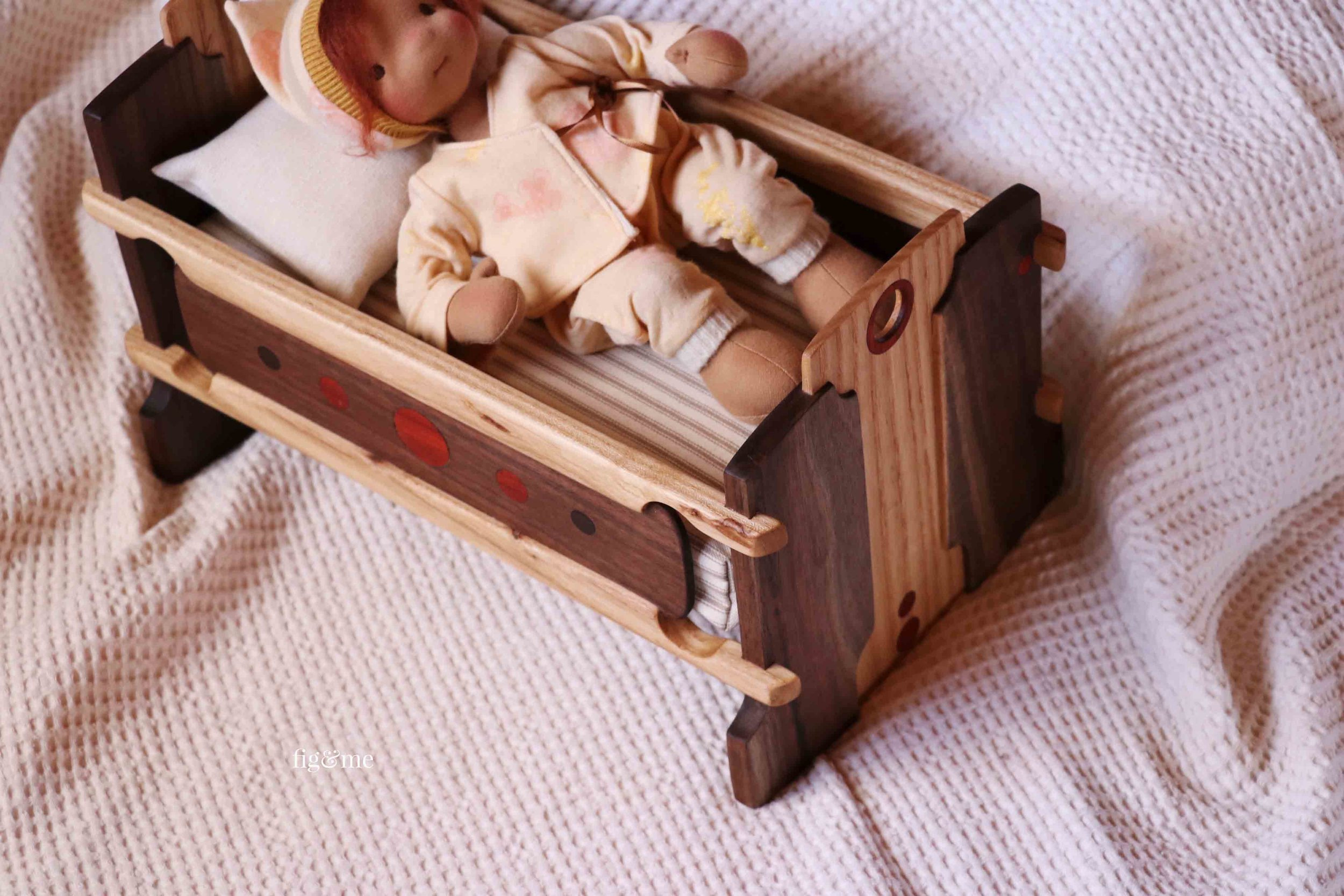 Kasja's wooden cradle, made of exotic hardwoods and with great care and detail.