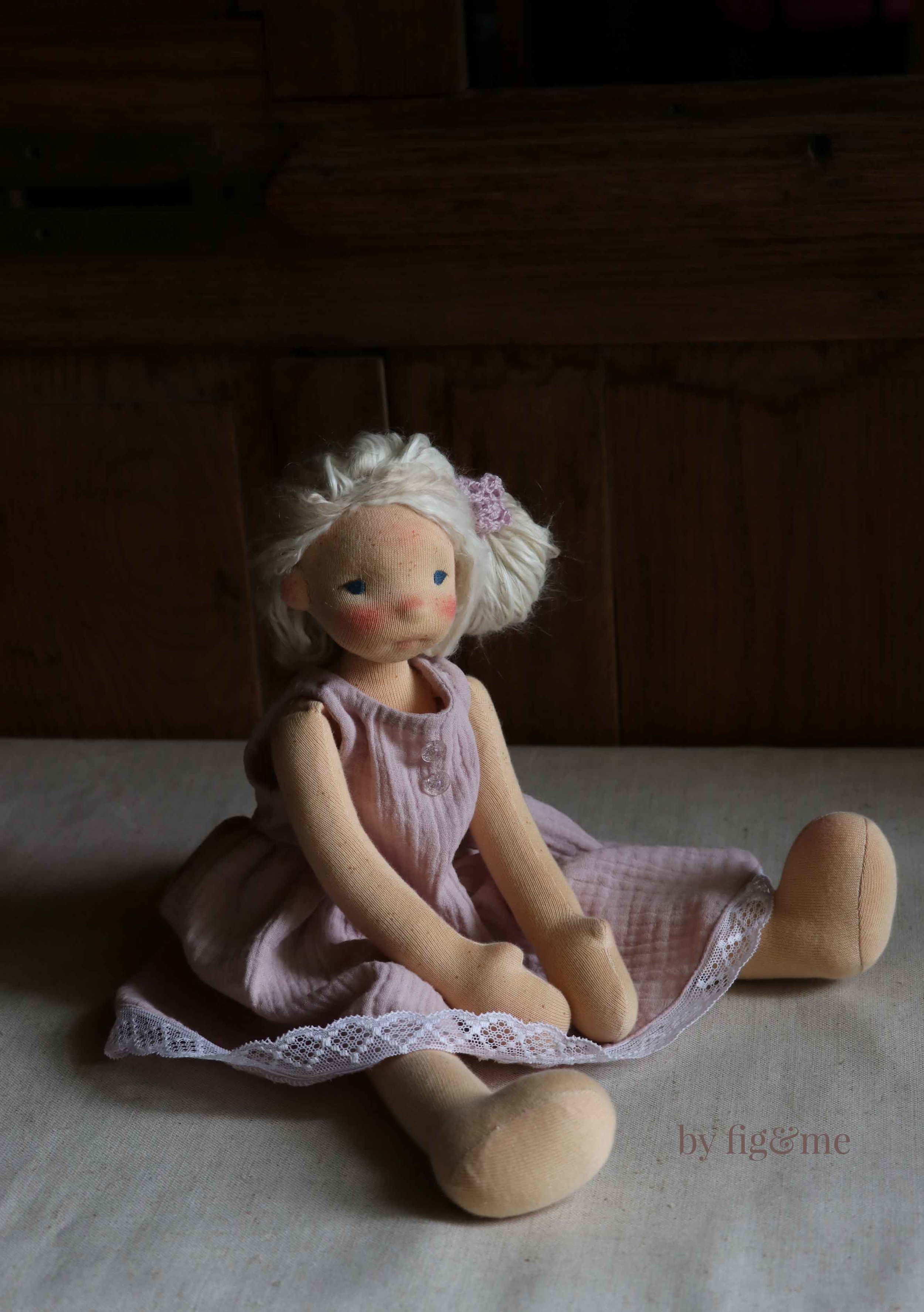 Anwen modeling her new doll dress, by Fig and Me.