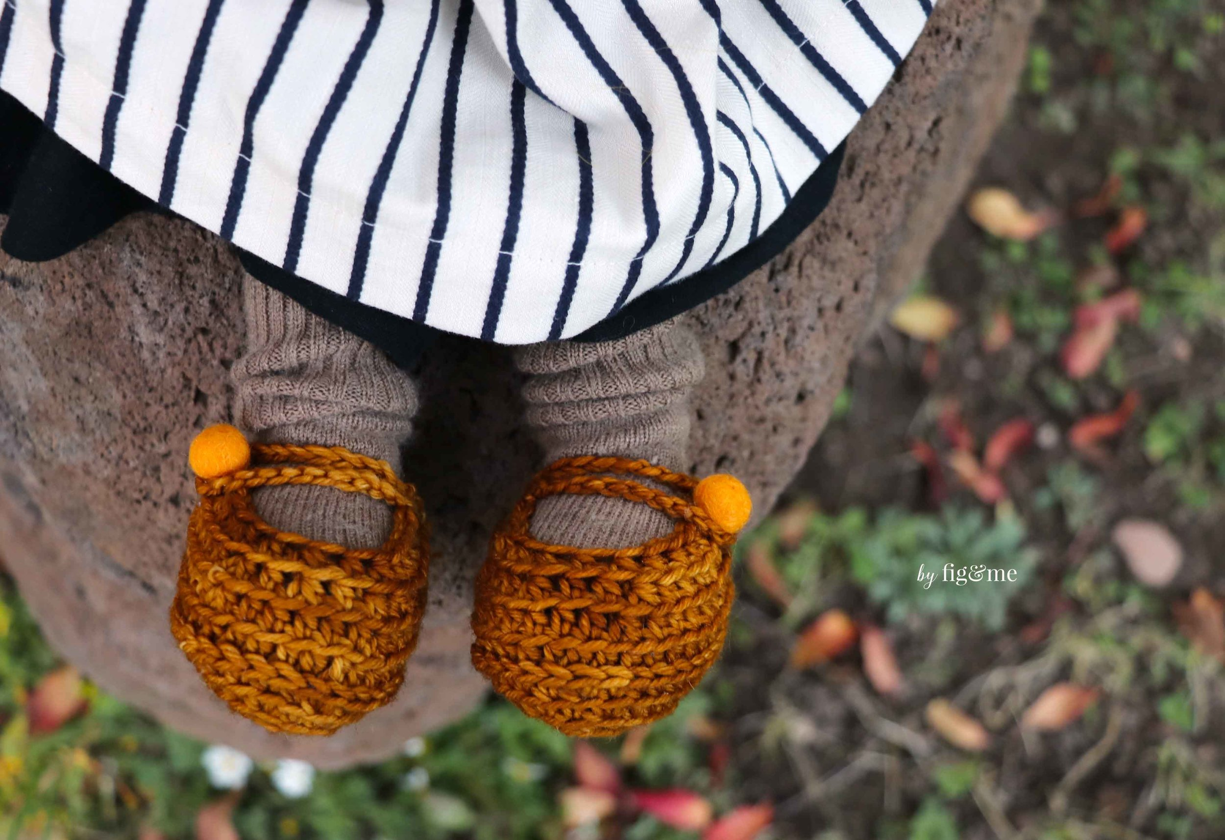 Rye wears handmade crochet doll shoes with wool felt beads. By Fig and Me.