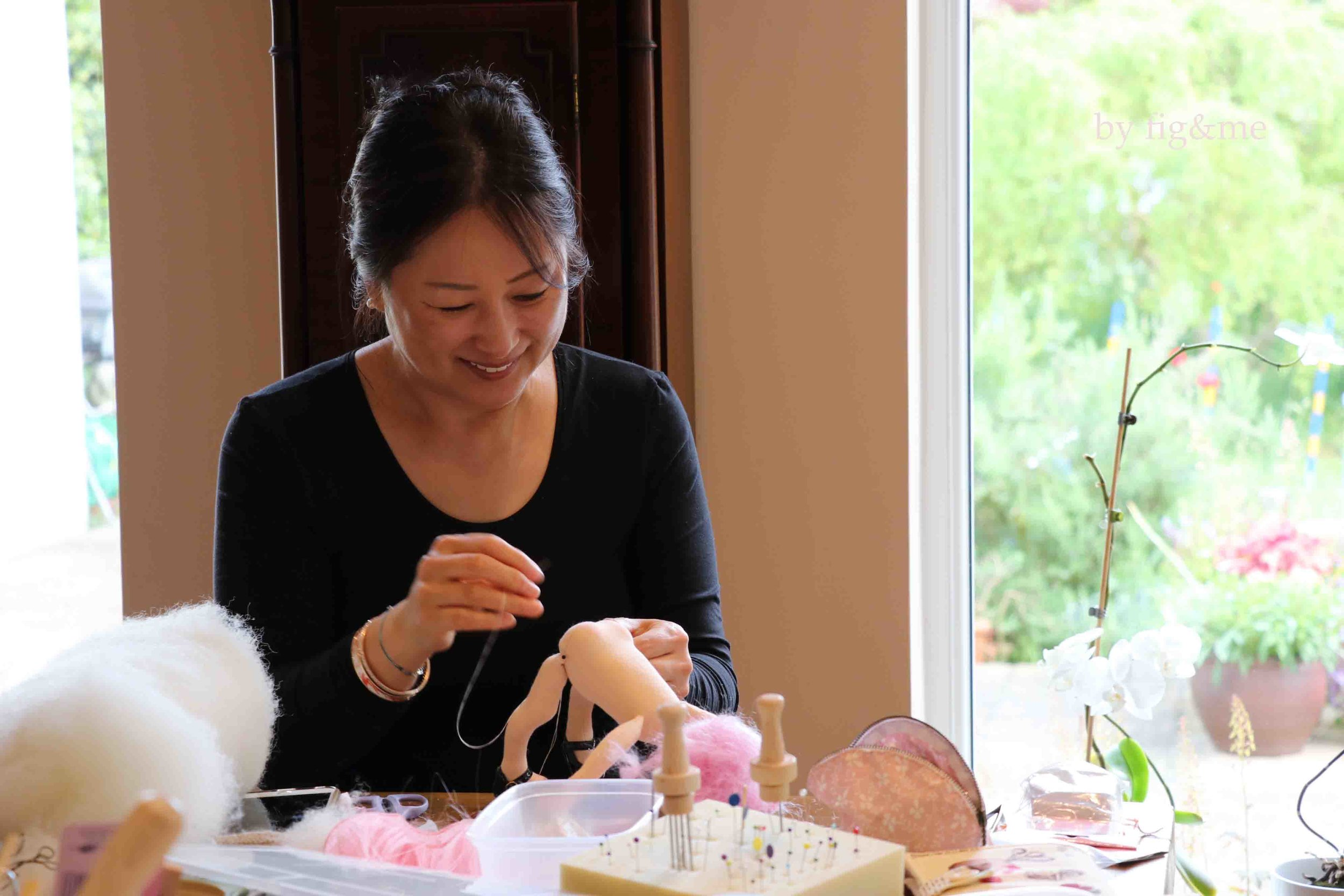 Eunice, deep in concentration working on her little doll. Fig and me doll workshop.