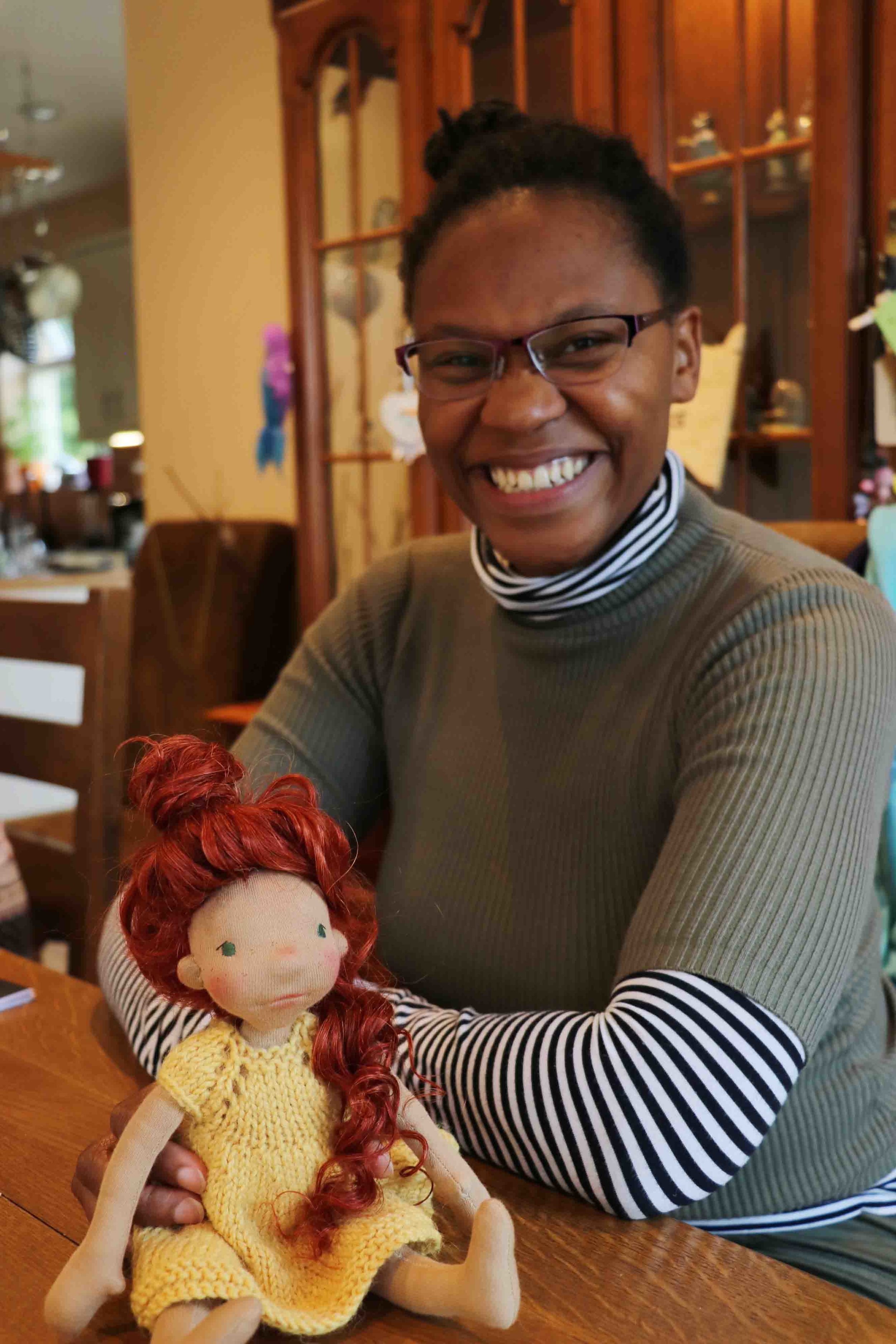 Sephora is a ray of sunshine. She had us all in stitches laughing and thanks to her I know of Sticky Toffee Pudding. Here she is holding her beautiful doll. Fig and me doll workshop.