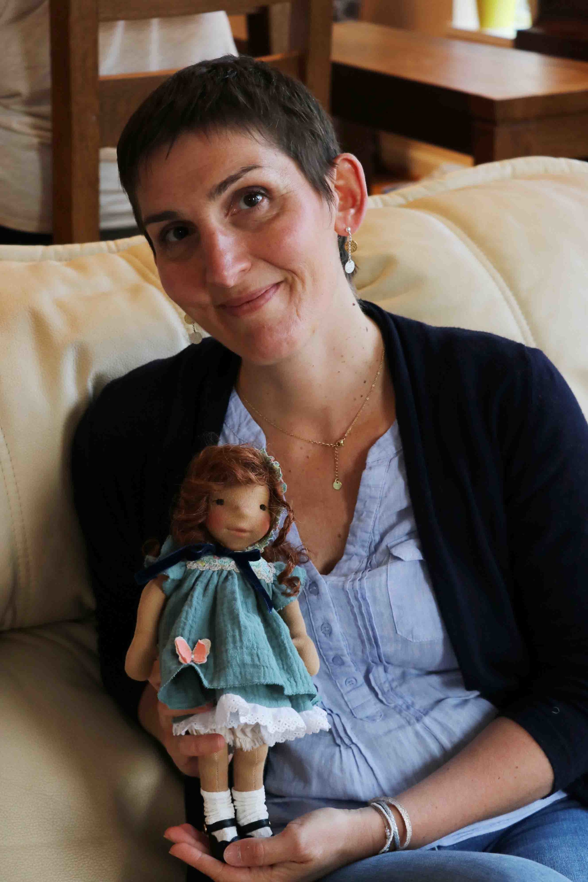 Sweet and thoughtful Benedicte holding her gorgeous doll. All my students brought clothing to dress their little dolls once finished. They are all amazingly talented seamstresses! Fig and me doll workshop.