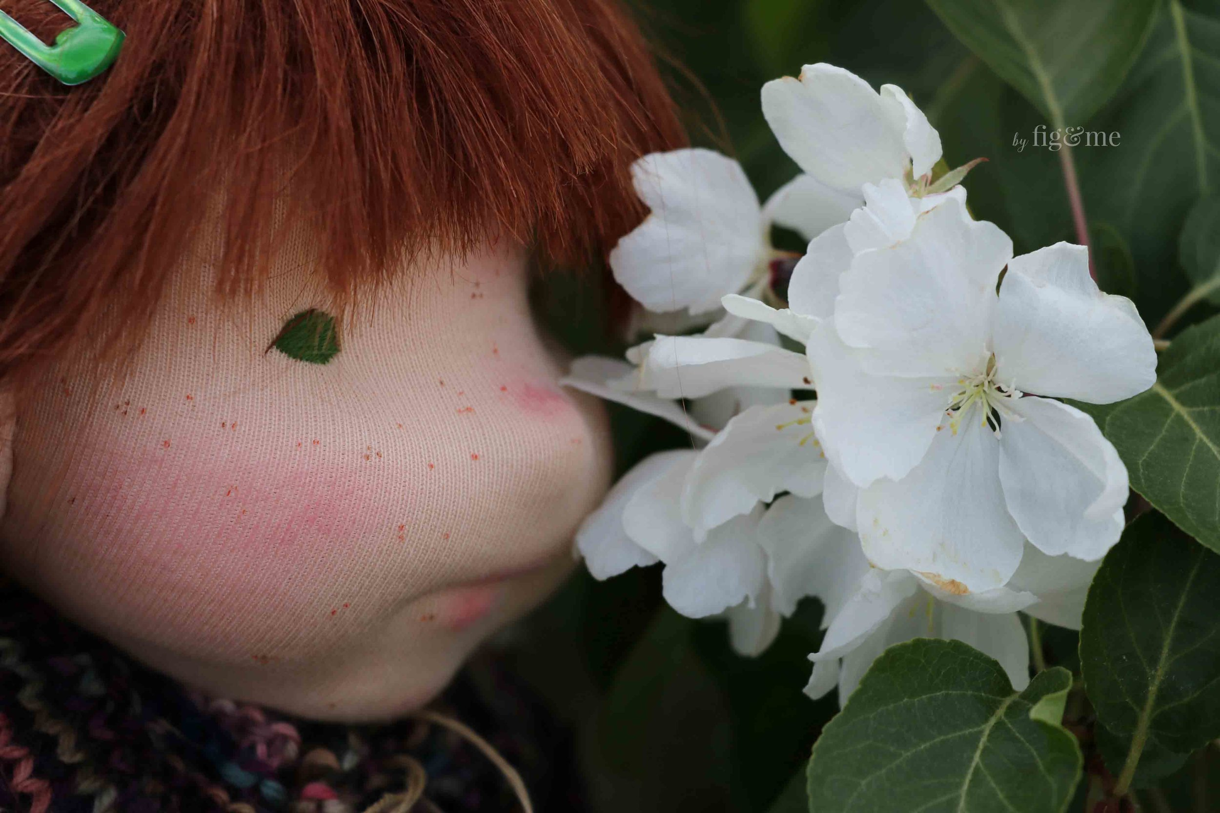 Bernadette smelling the crabapple flowers, by fig and me.