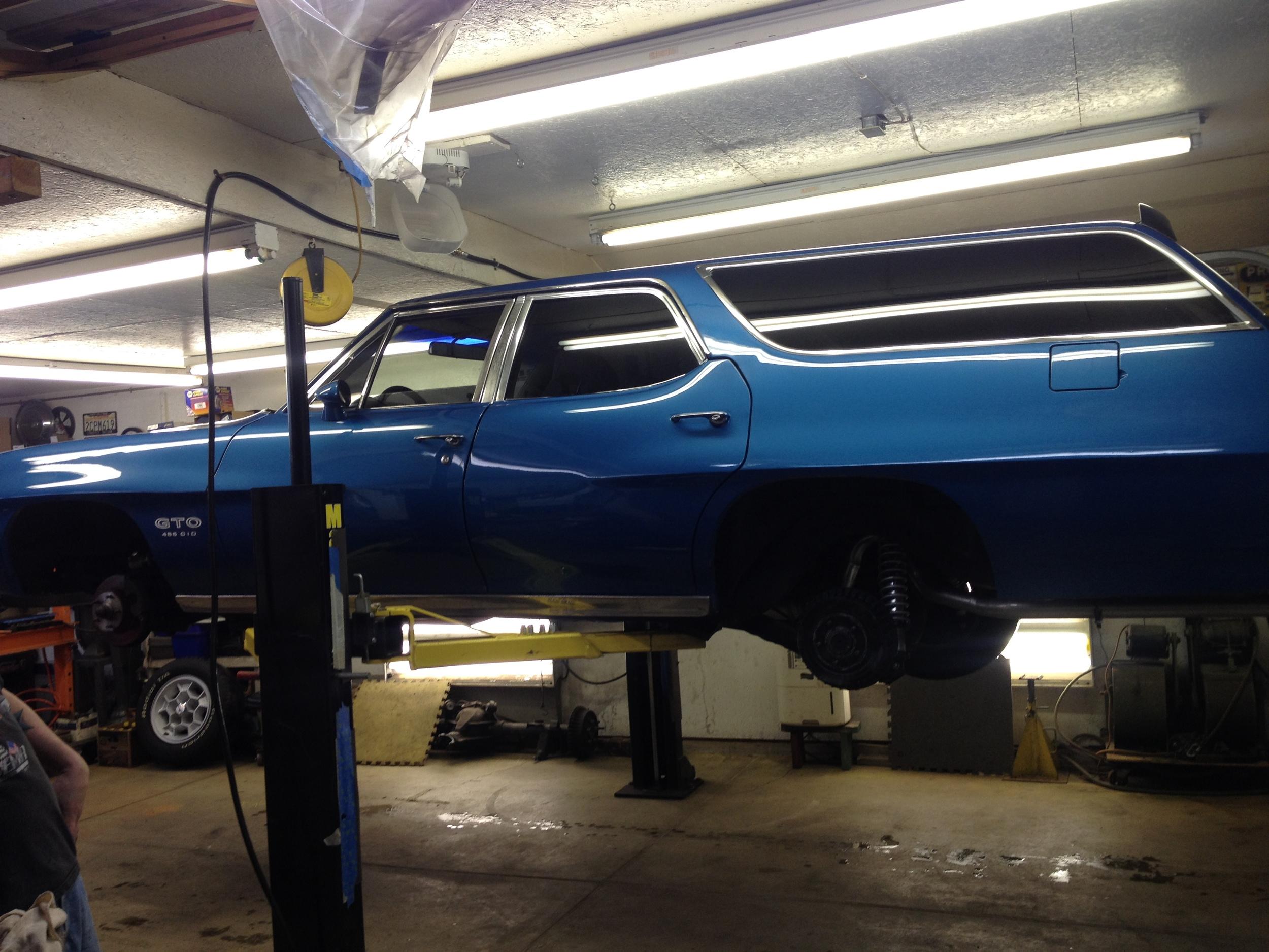 ON the hoist, wheels off, ready for work.