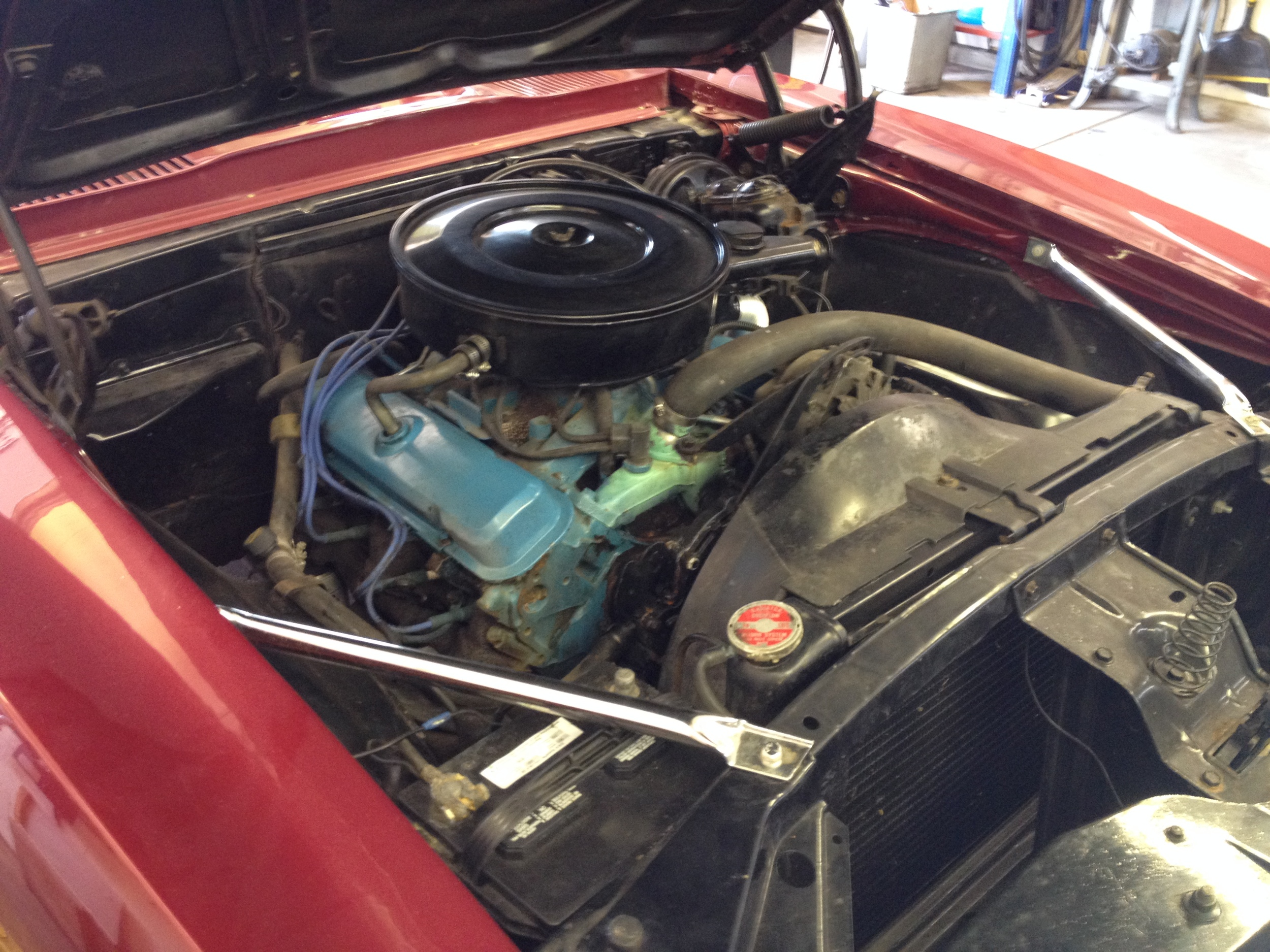 All original Pontiac 350. Original engine bay not too bad.