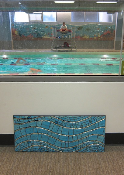 The piece will be hung here, overlooking the pool mural