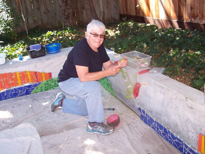 Artist Joyce Clements working on the hummingbird