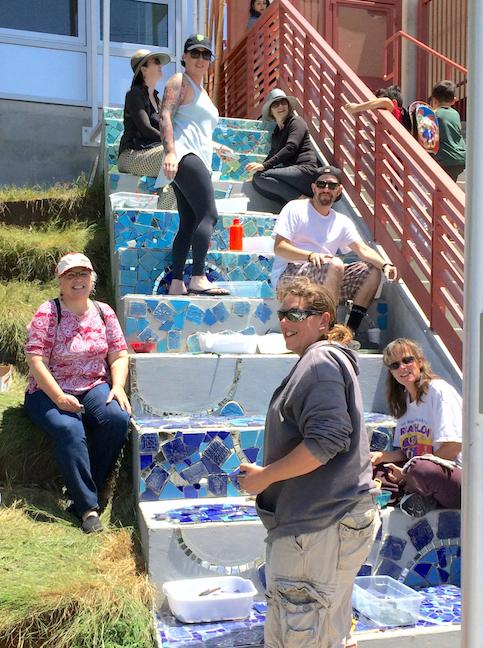 Jefferson Elementary School, Berkeley, CA. Volunteers help make the mosaic with the student tiles.