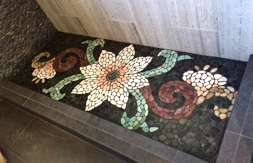 Flat cut pebble shower floor