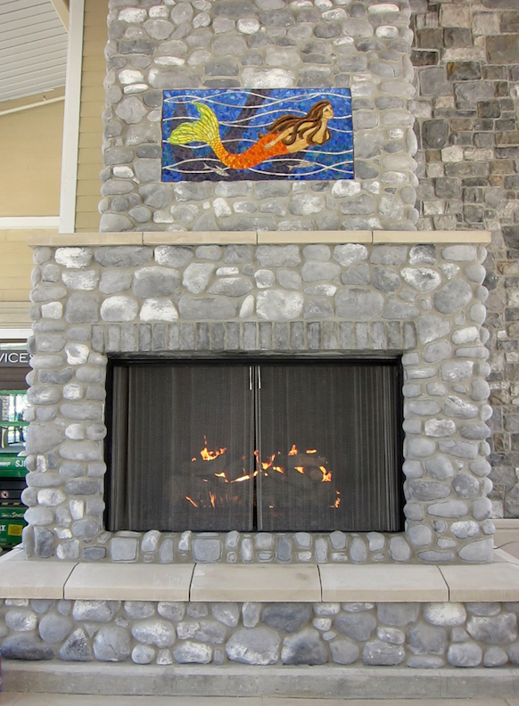 Installed on the enormous fireplace at the center of the mall.