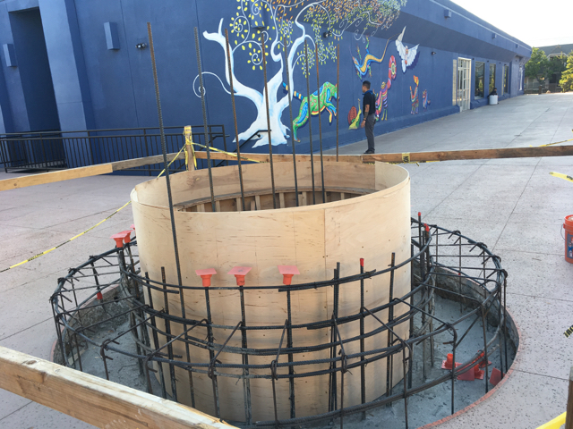 Under construction: the wall and circular seating area where the lizard will live.