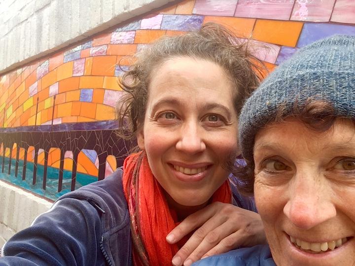 Rachel and Carol Bevilacqua installing the Pier Mural in Manhattan Beach