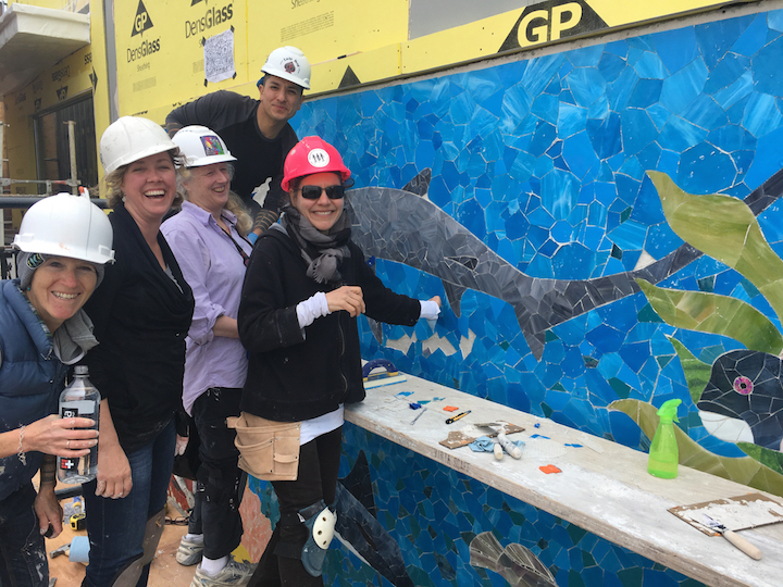 Molly Benson (second from the left) jumped in and helped install for a day.