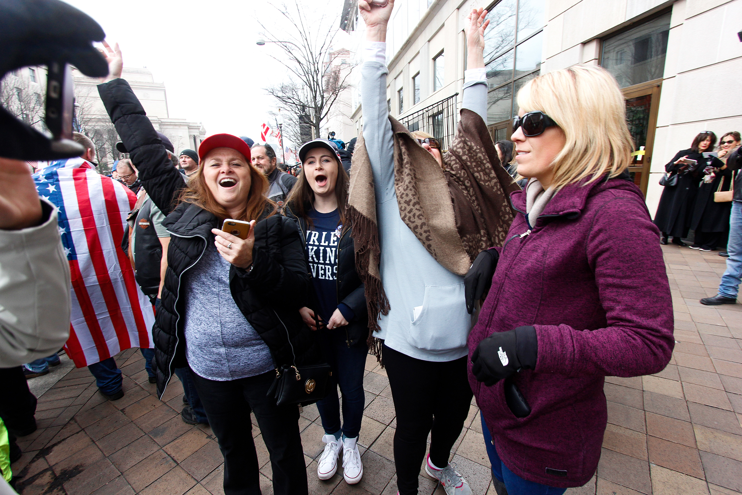 Trump supporters cheer as Donald Trump is sworn in as the 45th President of the United States on Jan. 20, 2017.