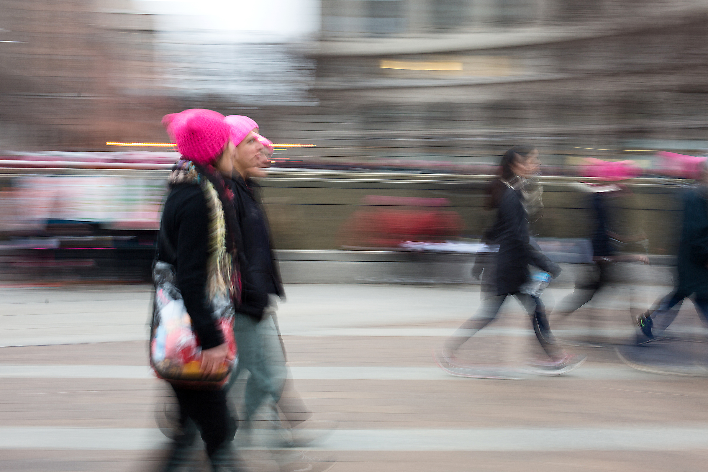 """Protesters wearing """"pussy hats"""" headed to the metro as the crowd at the 2017 Women's March in Washington D.C. began to disperse."""