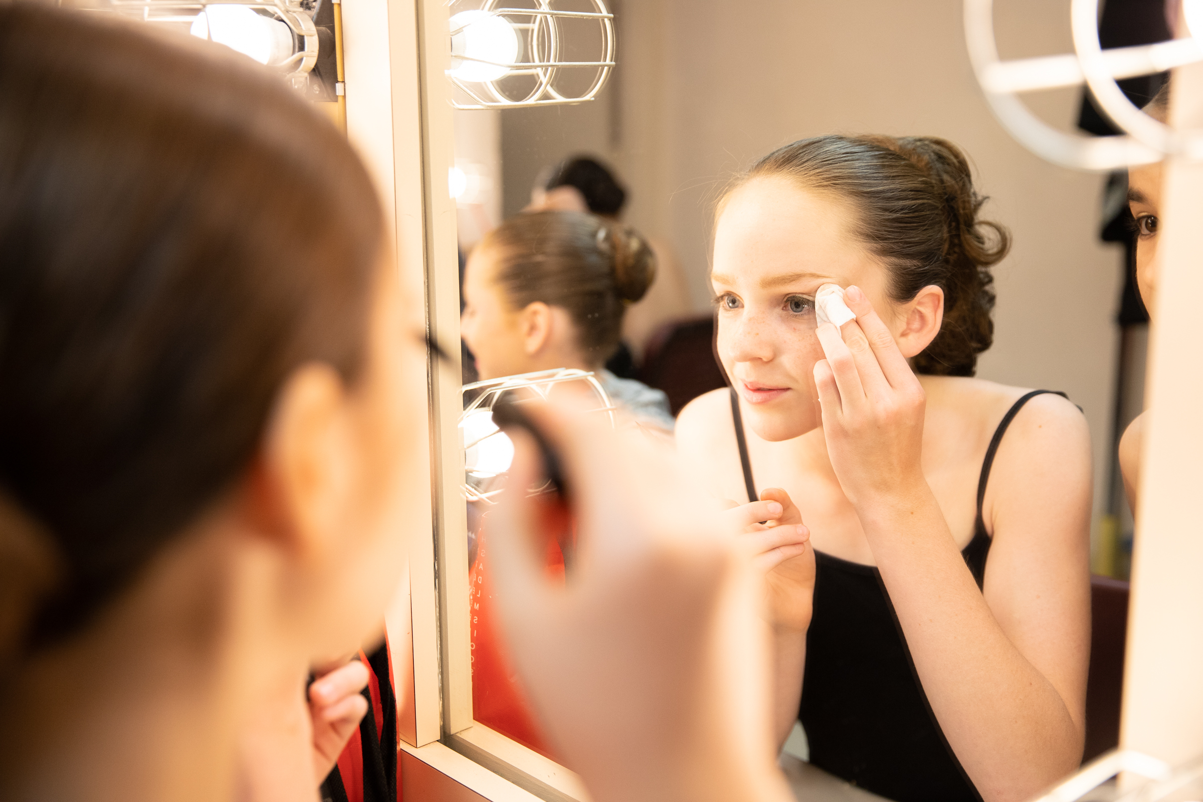 """Polina Bortok applies her makeup backstage before Western Ballet's production of """"The Nutcracker"""" at the Mountain View Center for the Performing Arts on Dec. 2, 2018."""