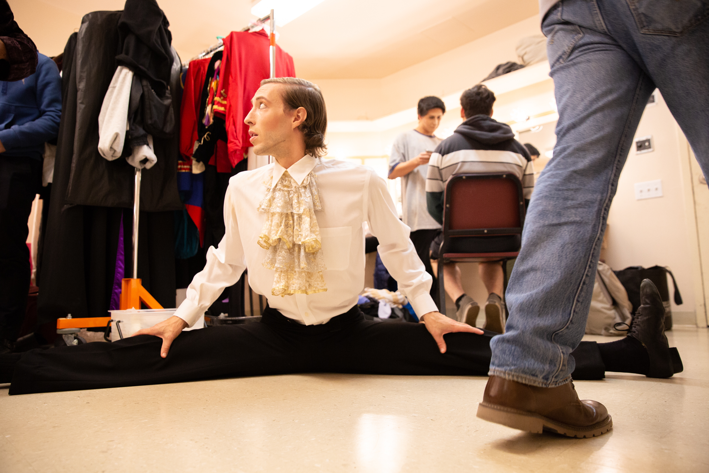 """Joe LaChance, who plays the Snow King, stretches in the men's dressing room backstage before Western Ballet's production of """"The Nutcracker"""" at the Mountain View Center for the Performing Arts on Dec. 2, 2018."""