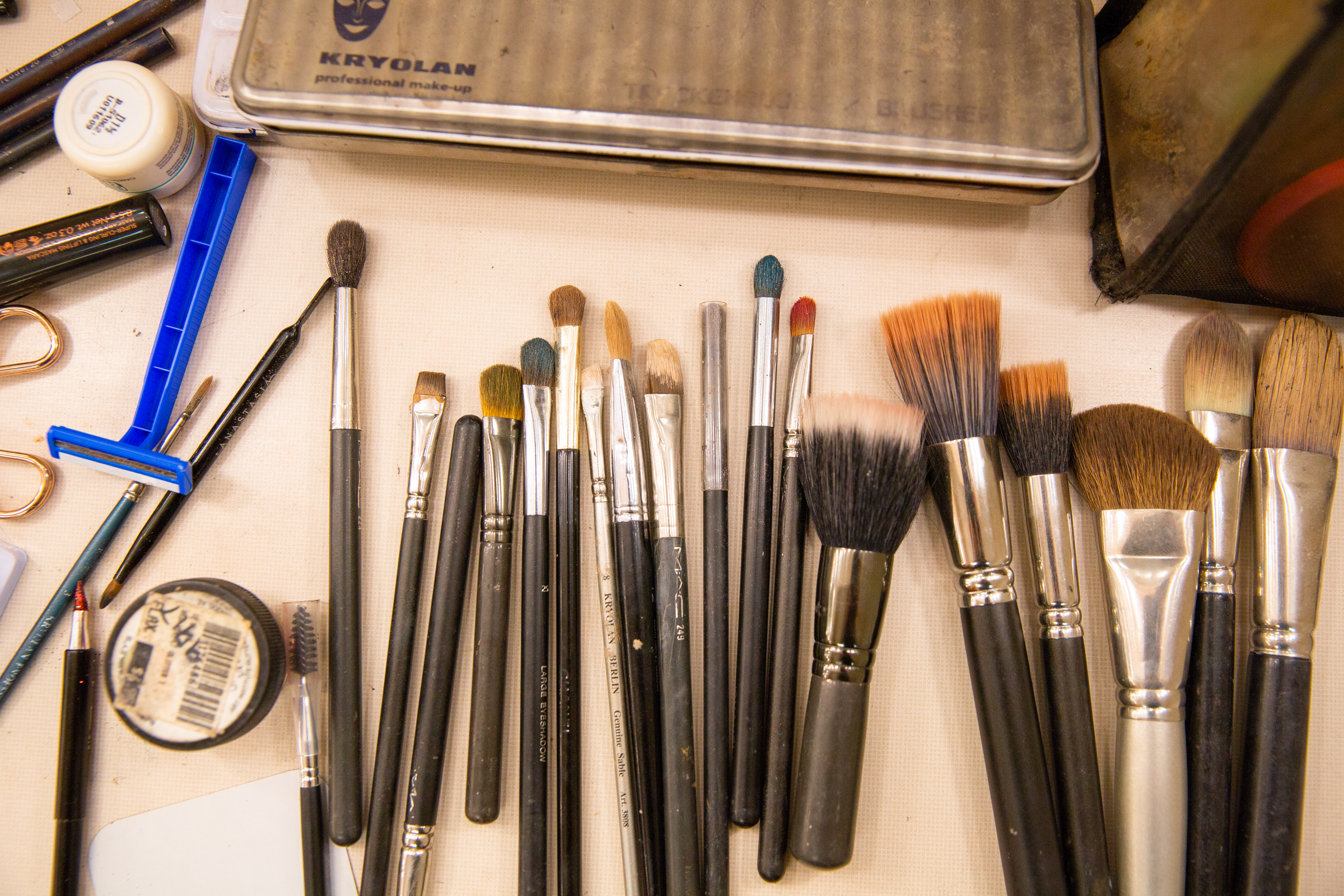 """Brushes covered in makeup in the men's dressing room backstage of Western Ballet's production of """"The Nutcracker"""" at the Mountain View Center for the Performing Arts on Dec. 2, 2018."""