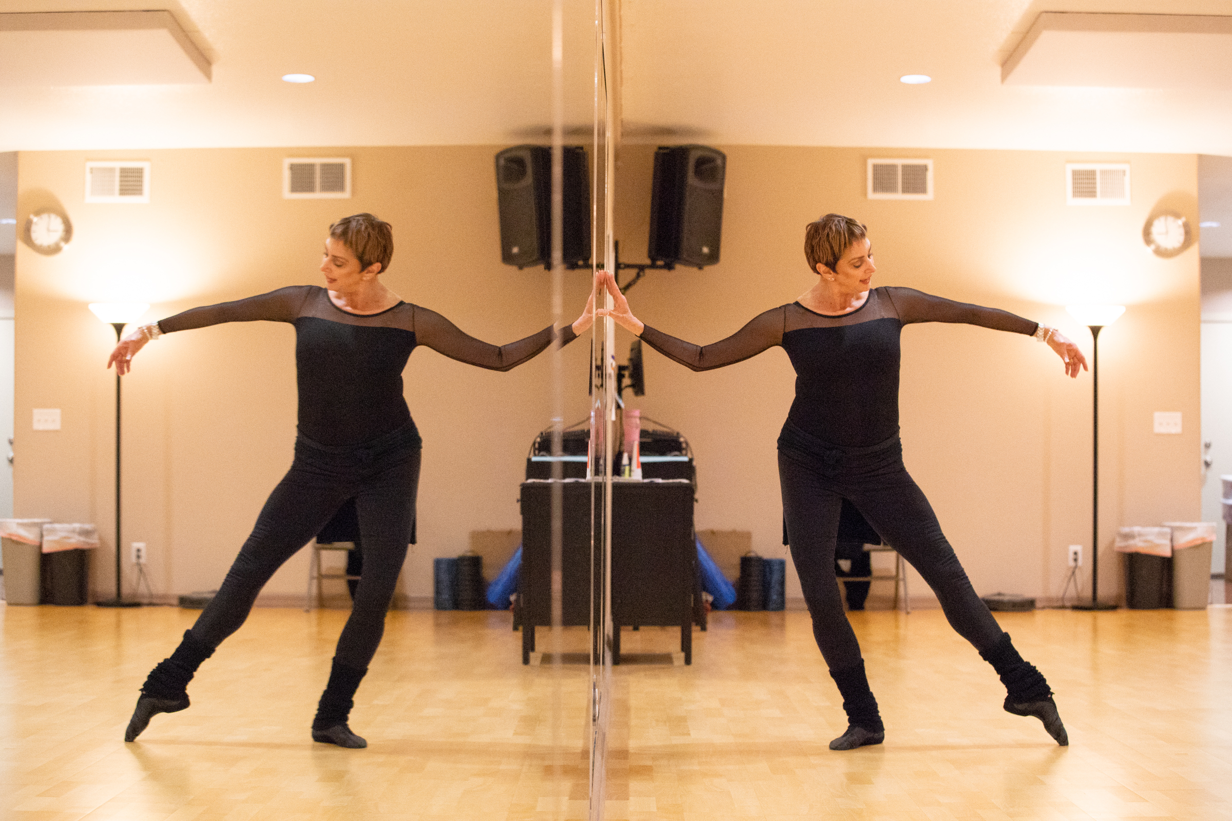 Stephanie Herman, who for years was a principal ballerina dancing for choreographer George Balanchine, demonstrates a ballet step at a performance space in Los Altos, California, on Nov. 29, 2018.