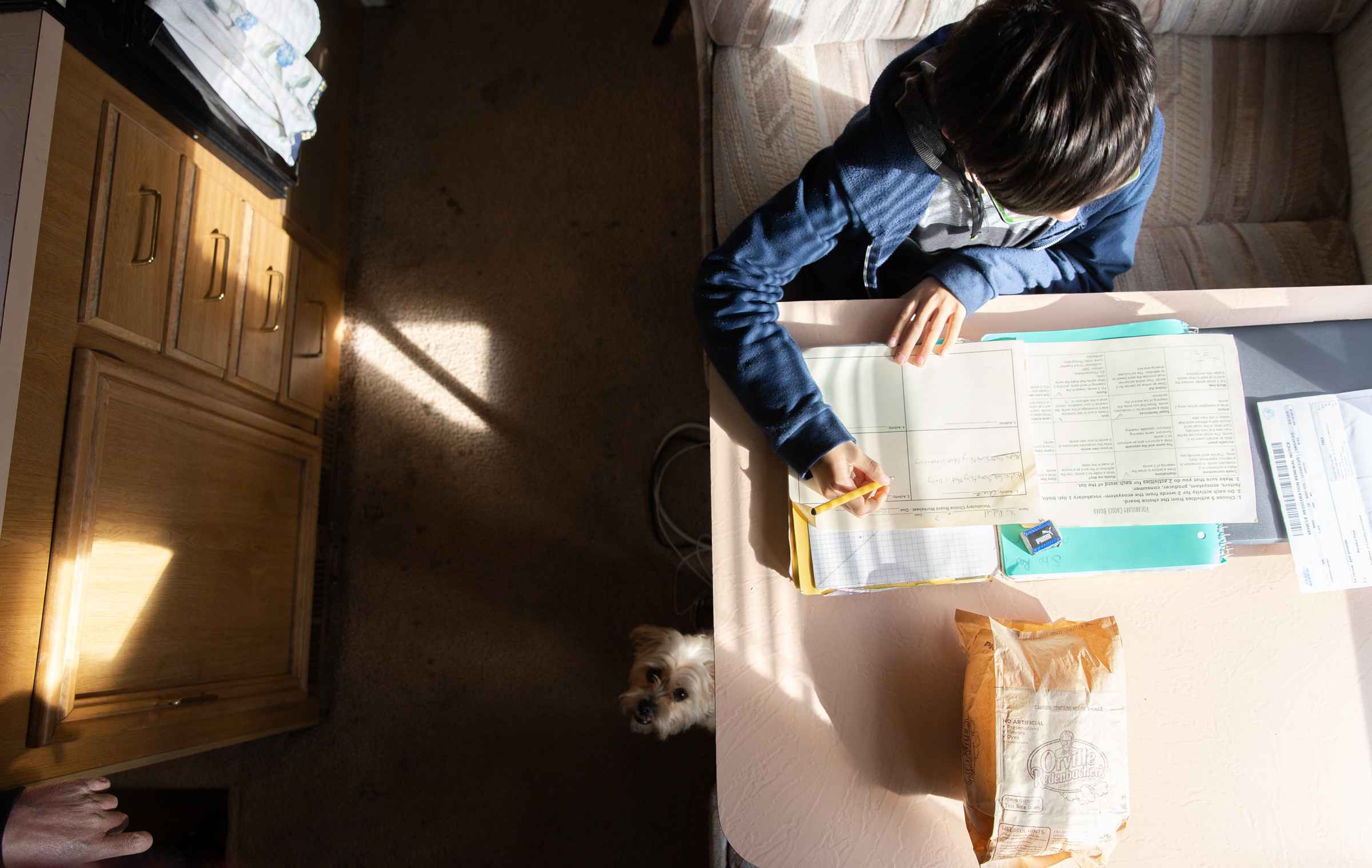 Scott Rodvold's son does his homework at a pull-out table in their RV in Mountain View, California, March 8.