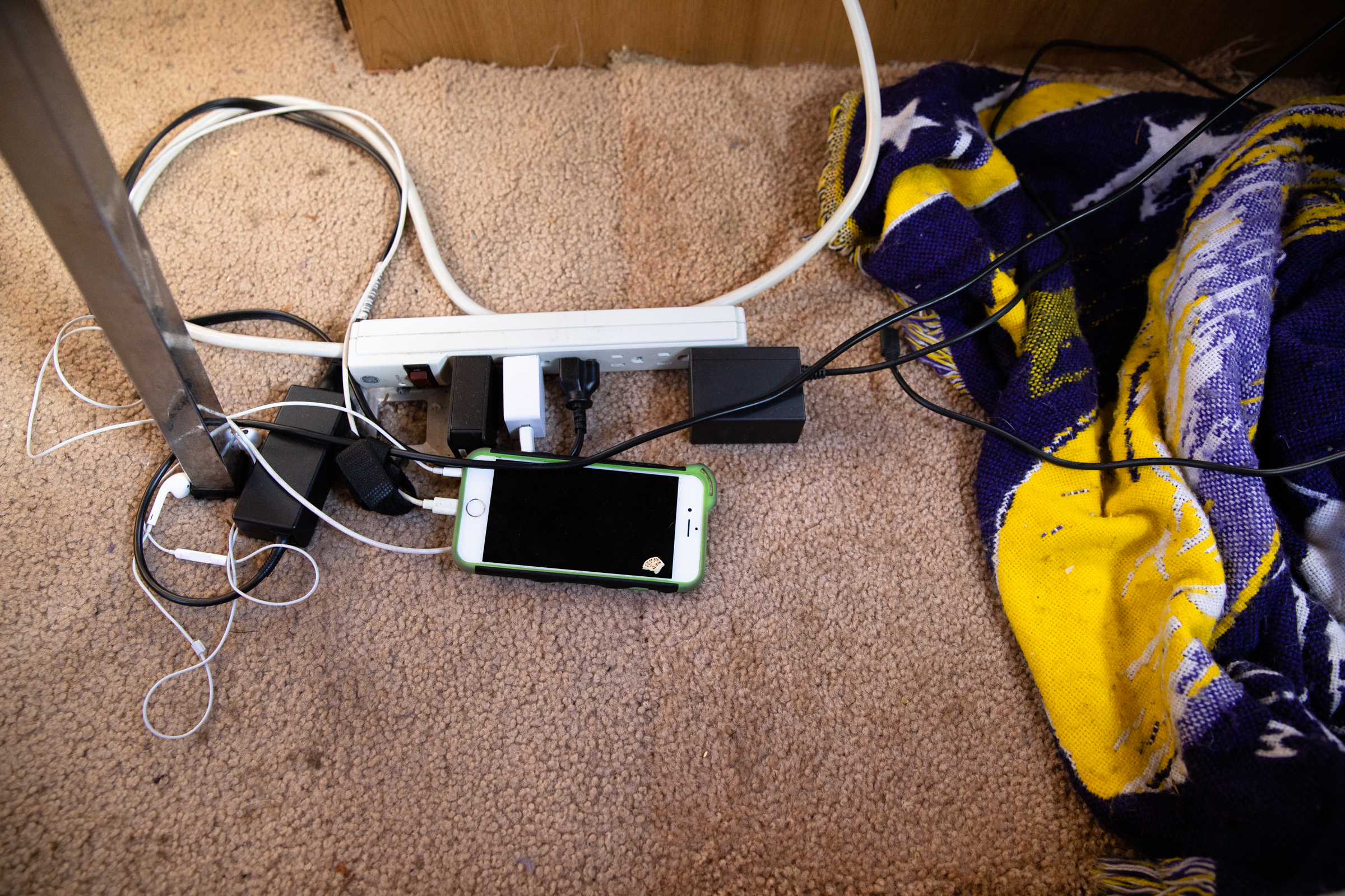 A phone charges in Scott Rodvold's motorhome along Continental Circle in Mountain View, California, on March 8.