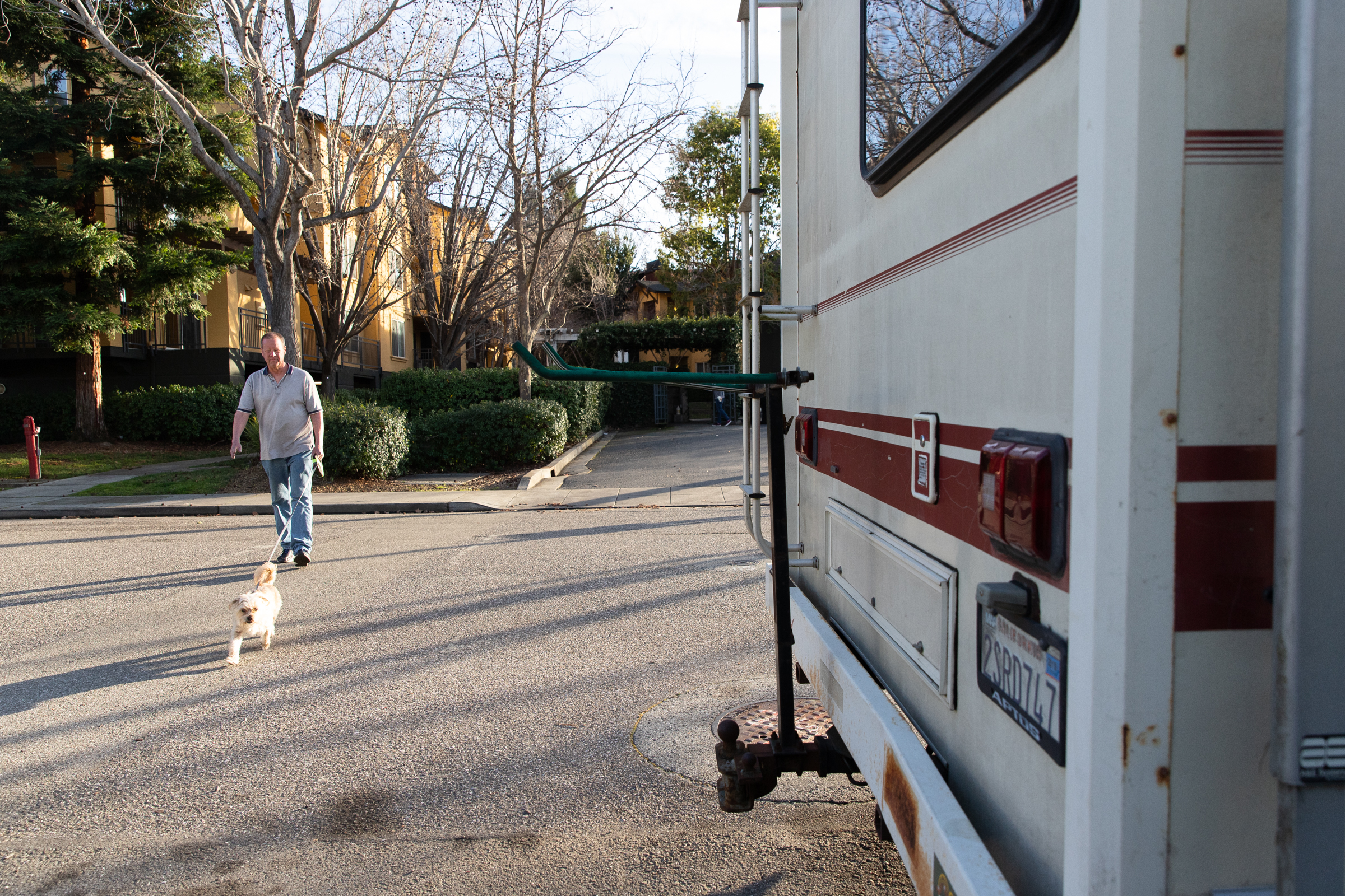 Scott Rodvold walks Winnie by the apartment he used to live in in Mountain View, California, on March 8.