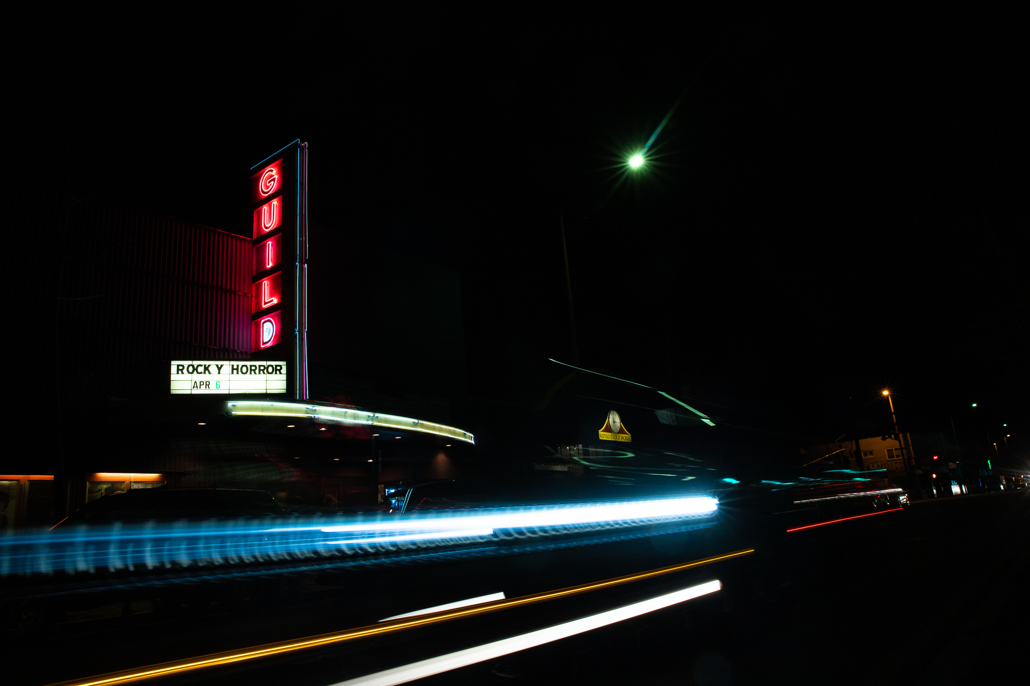 "Cars zoom by Landmark's Guild Theatre in Menlo Park before the monthly midnight showing of ""The Rocky Horror Picture Show"" on April 6. The cast first performed at the Guild in 2006, on Dec. 2 and 16. The show used to take place twice a month."