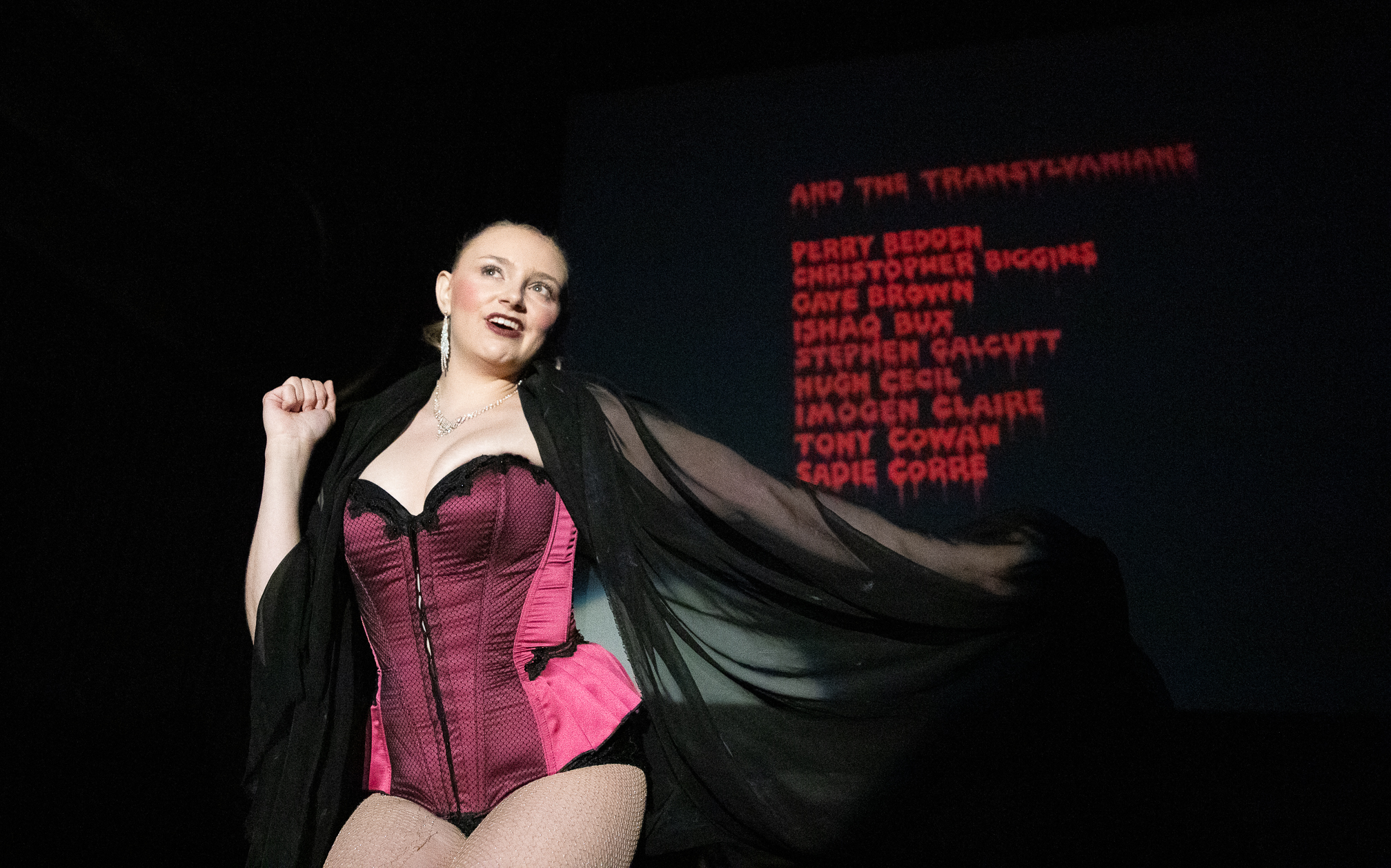 Katie Martin performs as Trixie during the closing credits of the film.