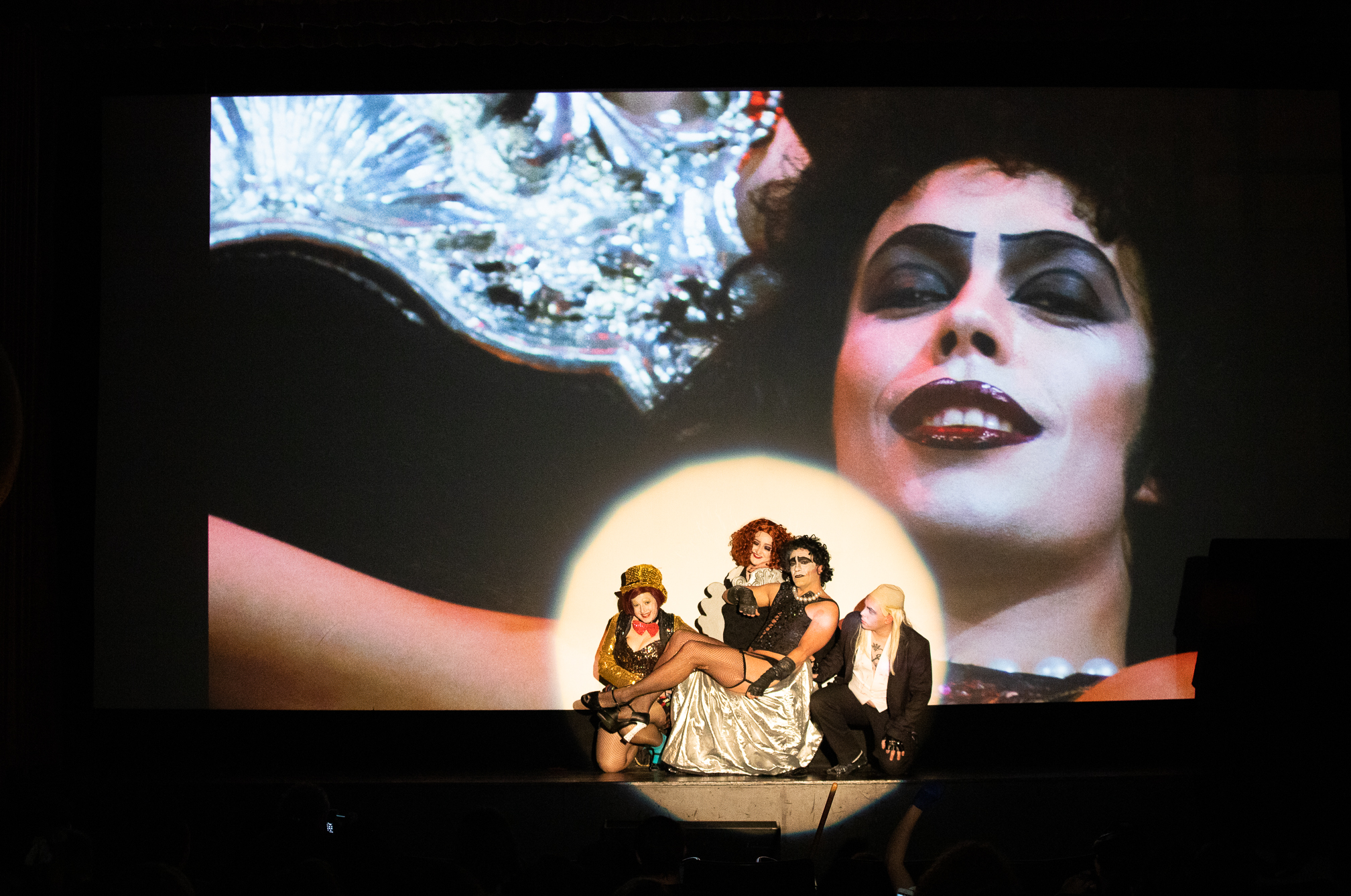 "The Bawdy Caste members Michael Delfino, Julie Shepard, Nina Loschiavo and Tim Sturm play Dr. Frank-N-Furter, Columbia, Magenta and Riff Raff in front of a screening of ""The Rocky Horror Picture Show"" at the Guild Theatre on April 6."